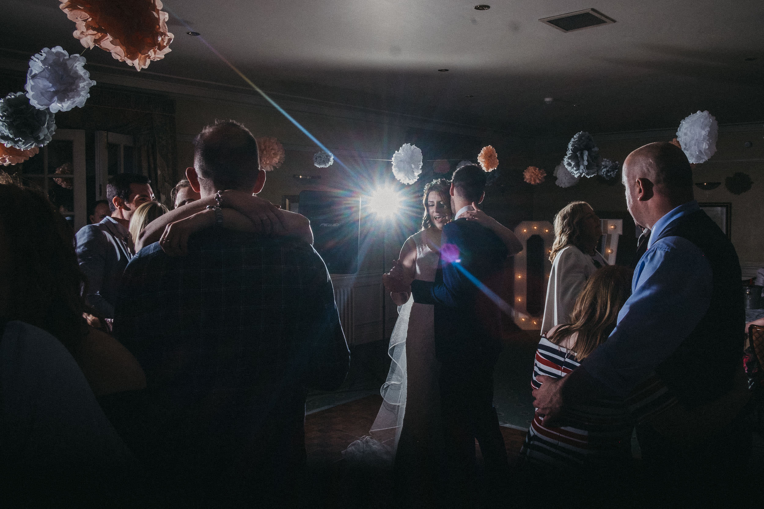 Guests join bride and groom on dance floor after first dance