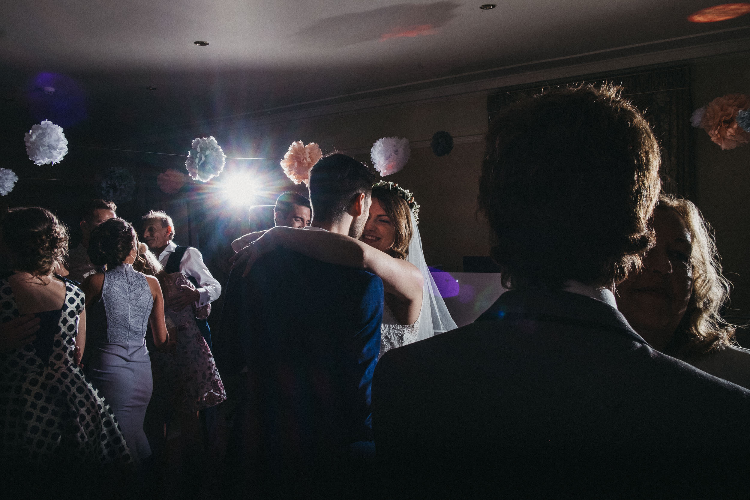 Bride  and groom share intimate moment on dance floor