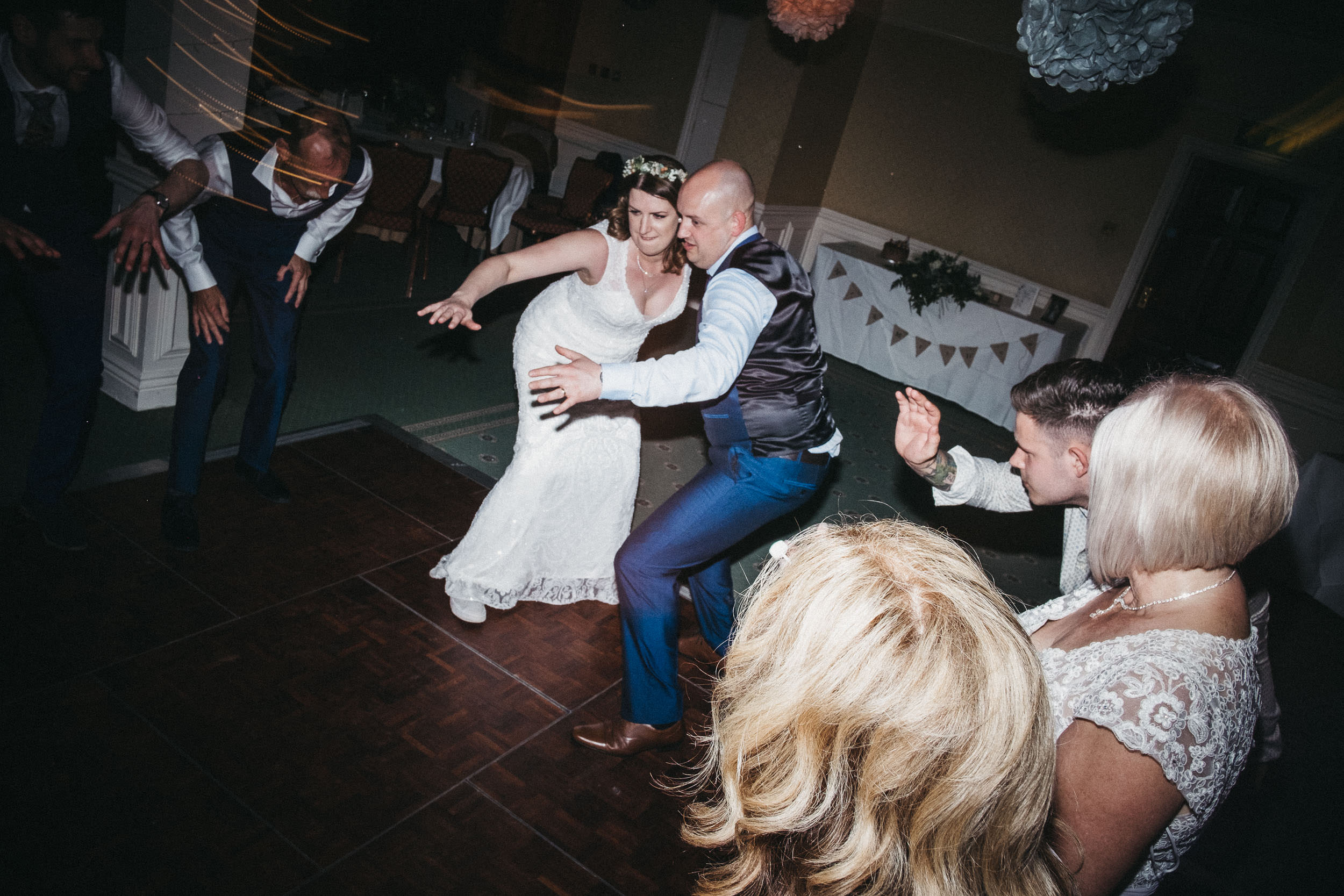 Bride and guest dancing to Praise You at wedding