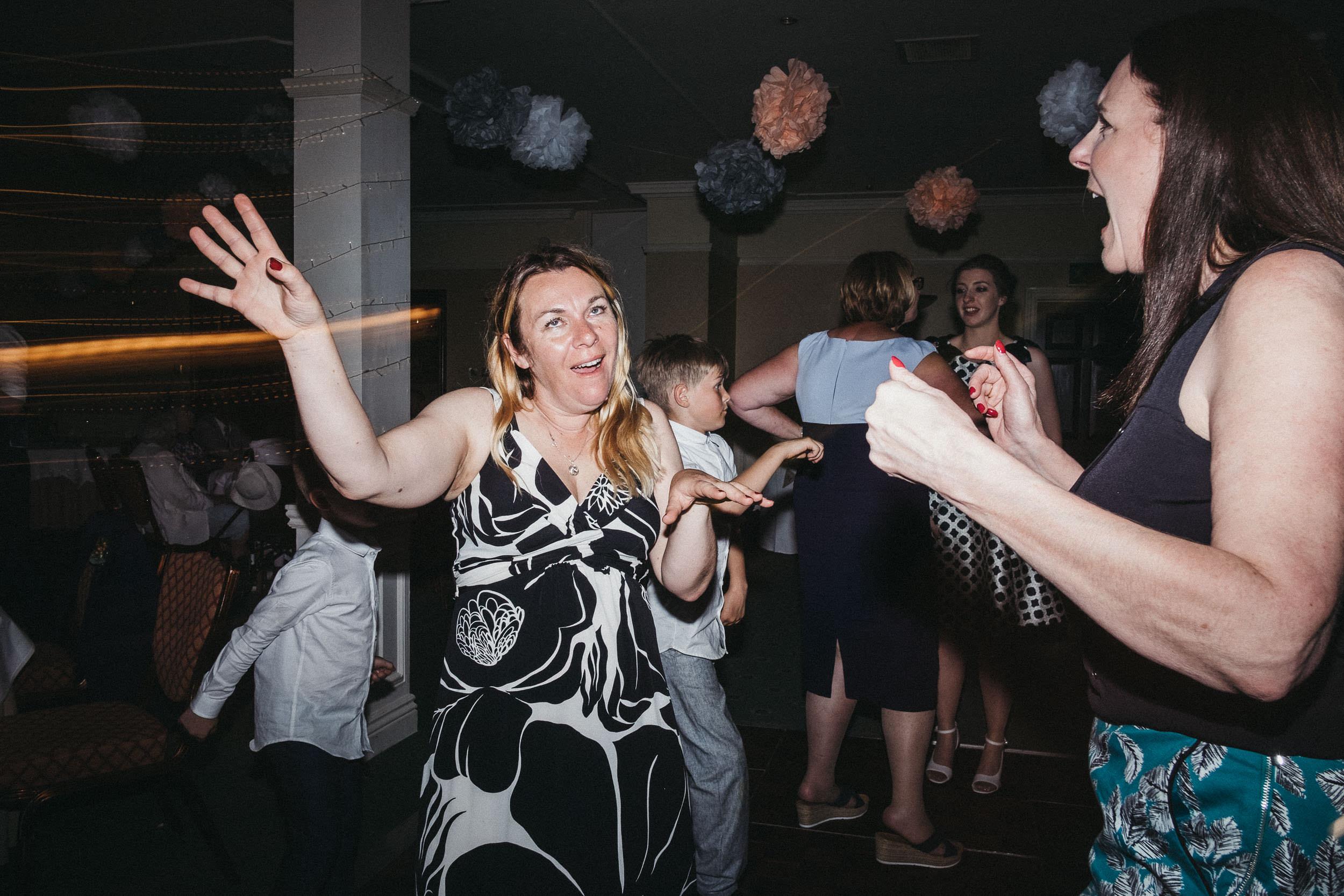 Wedding guest pulls funny face on dance floor