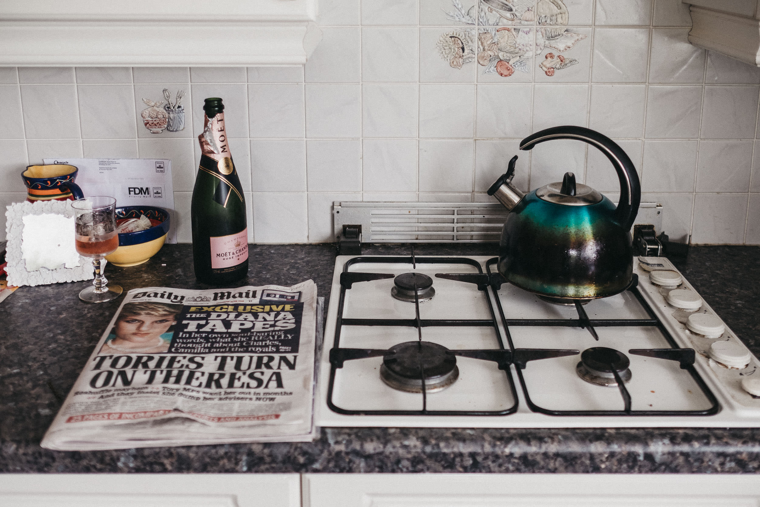 Newspaper kettle and champagne at bride's house
