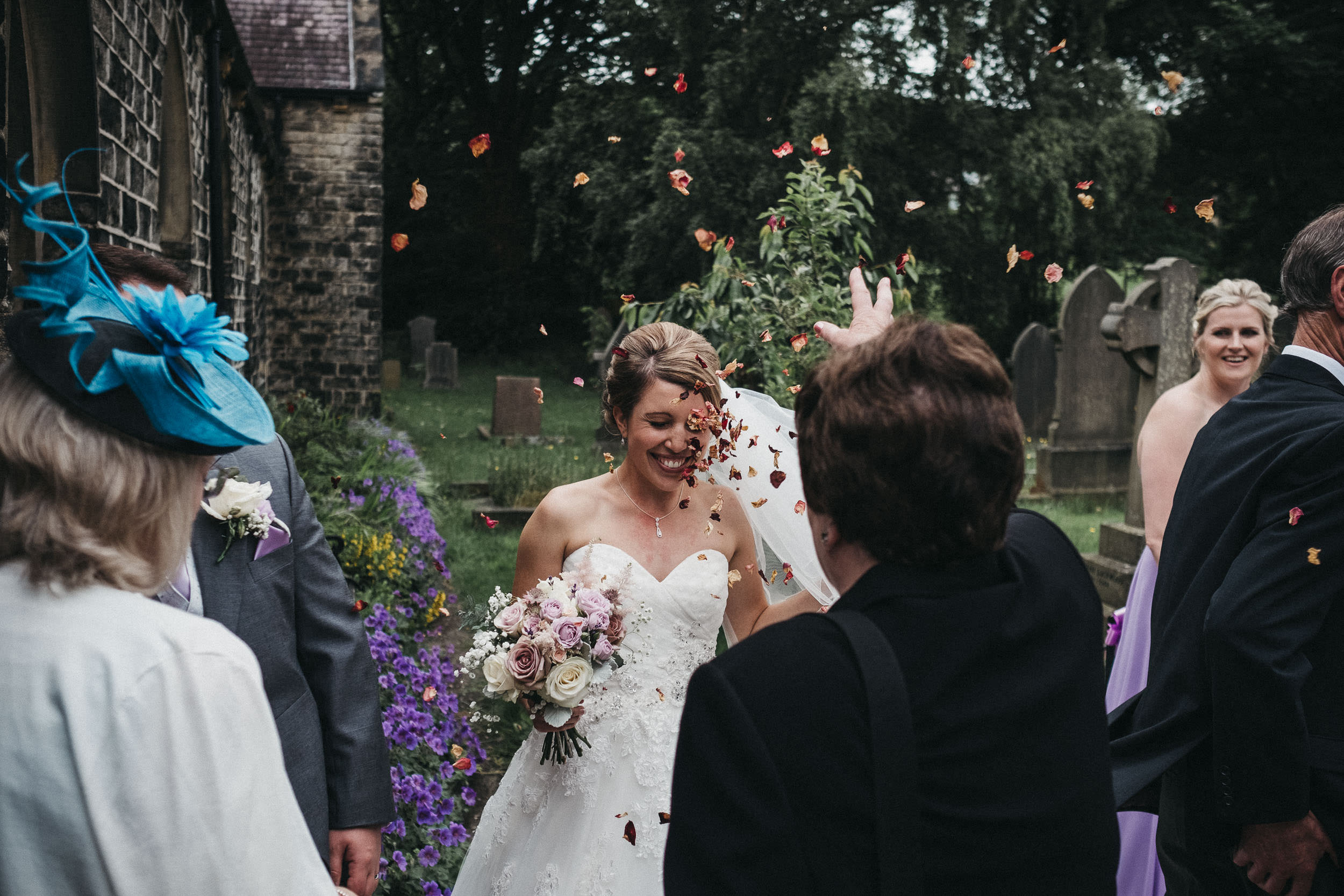 Funny photo showing wedding guest throws confetti in bride's face