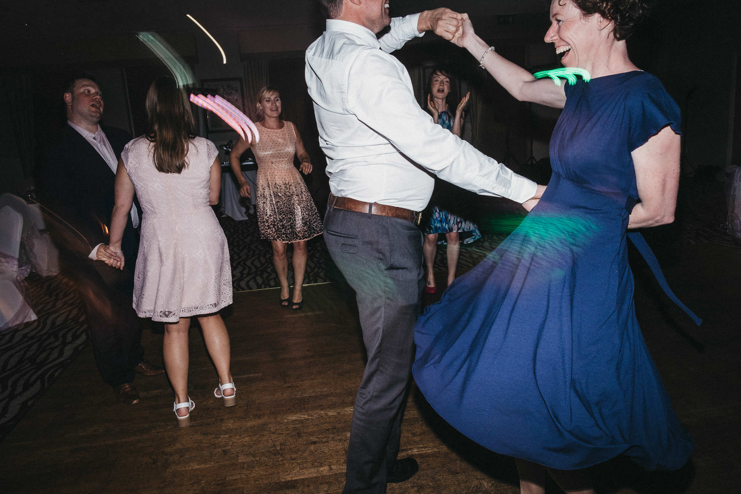 Guests dancing and smiling on dance floor