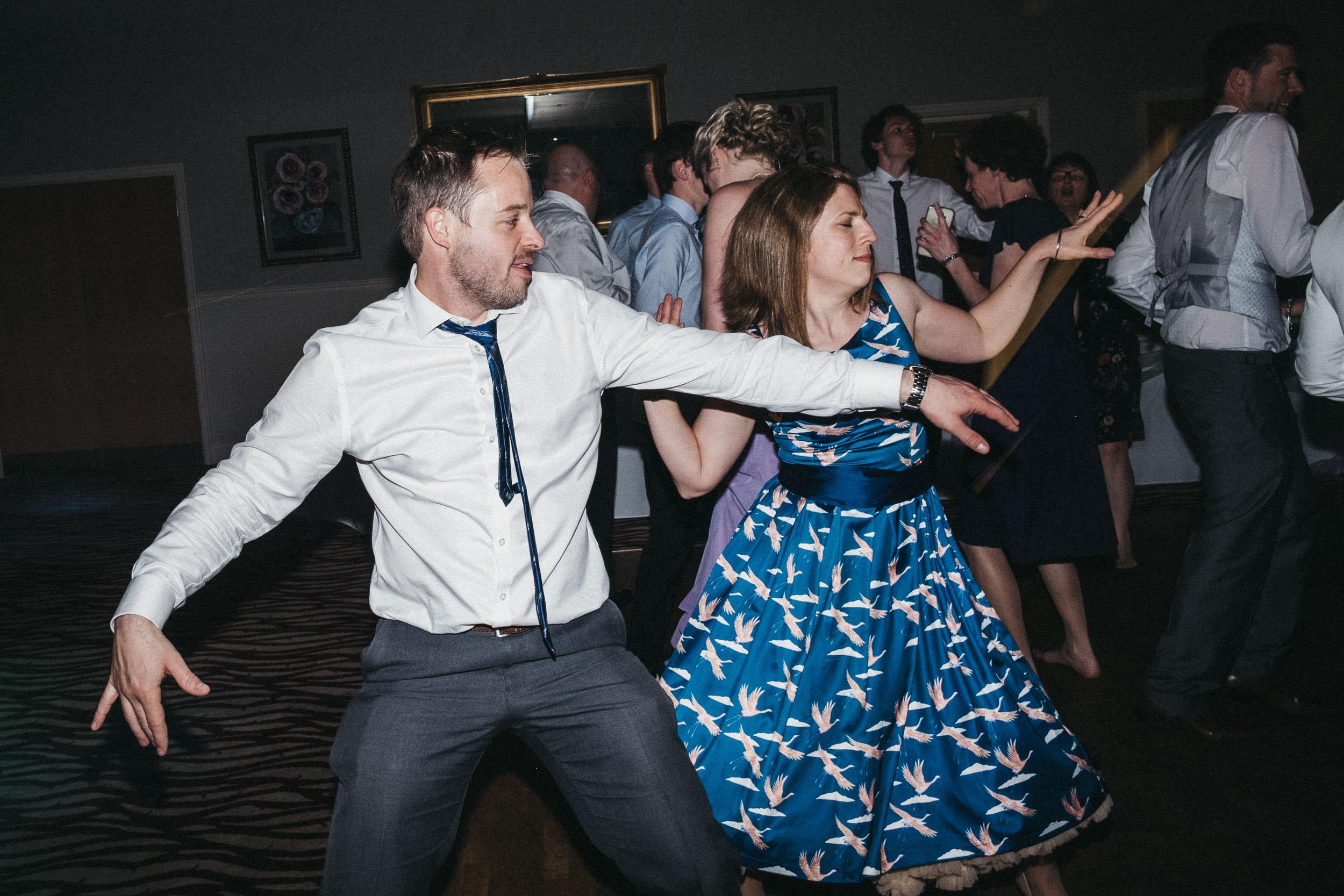 Wedding guests dancing in sync at Bagden Hall