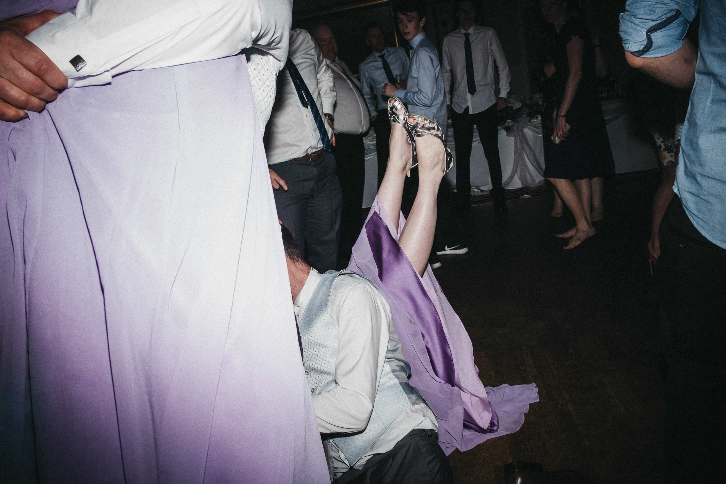 Bridesmaid falls on floor and legs shoot into the air