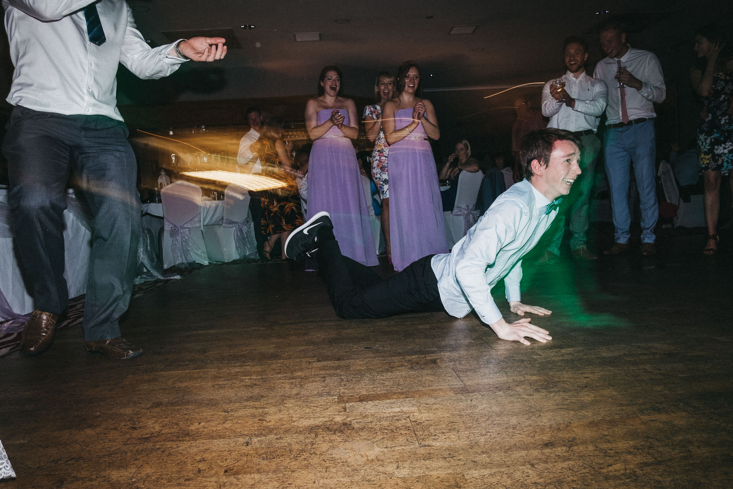 Young wedding guest breakdancing