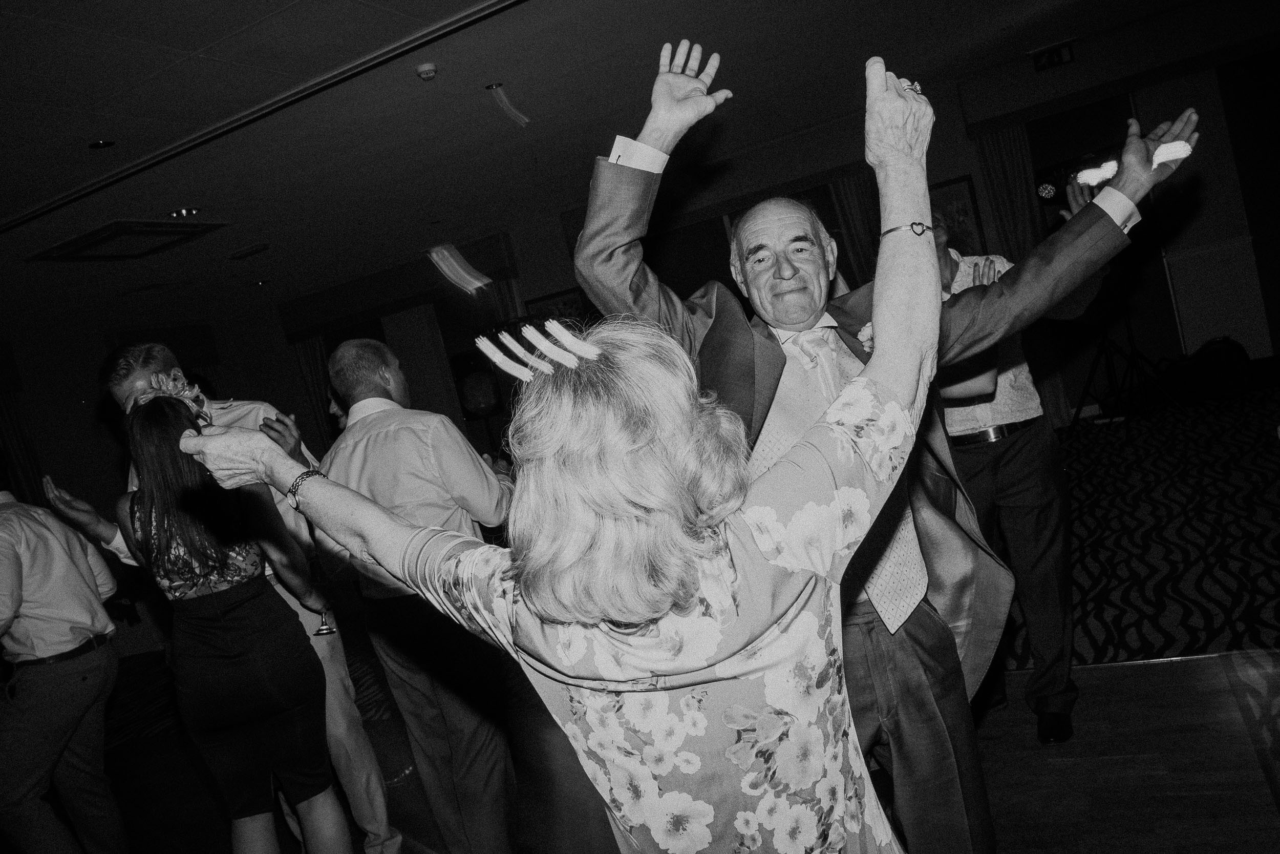 Black and white photo of father of the bride dancing