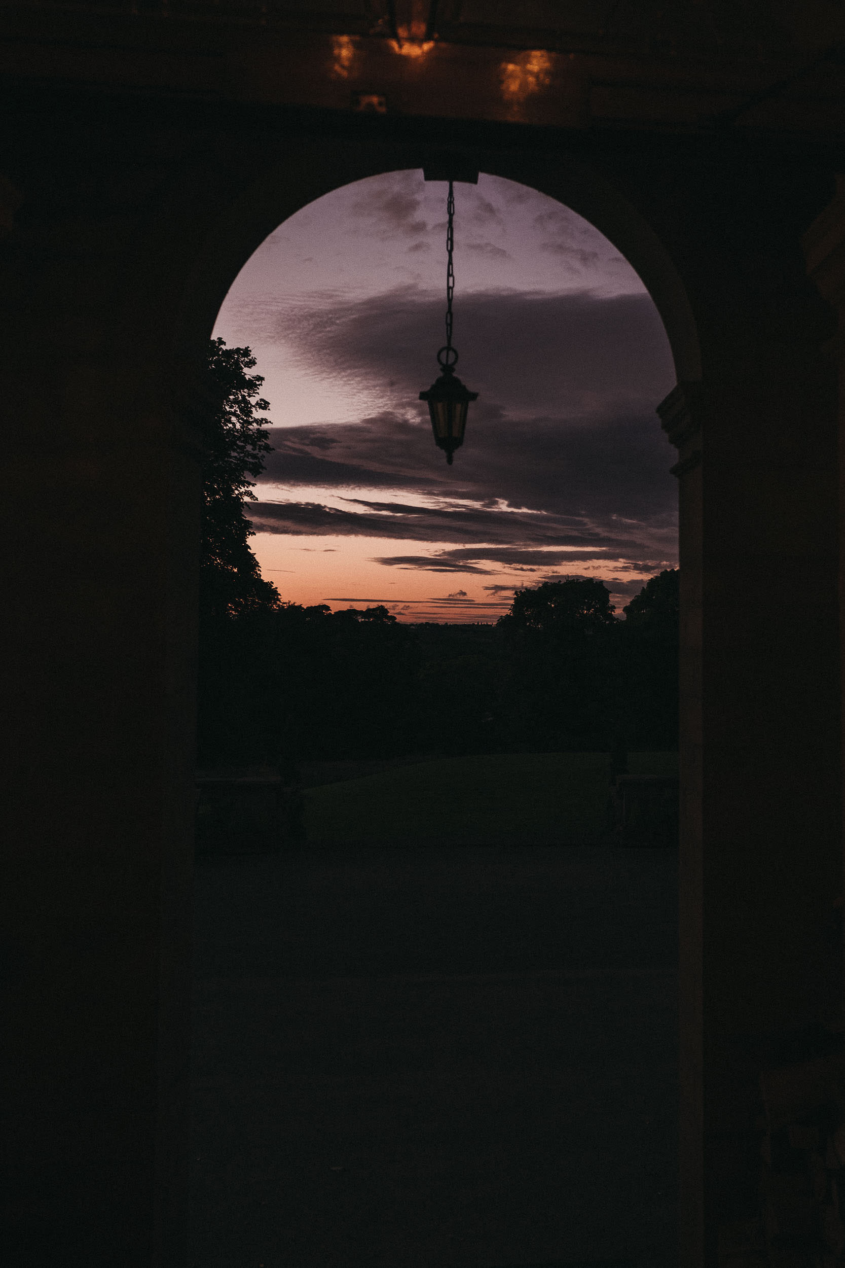 Sunset through the arched doorway at Bagden Hall