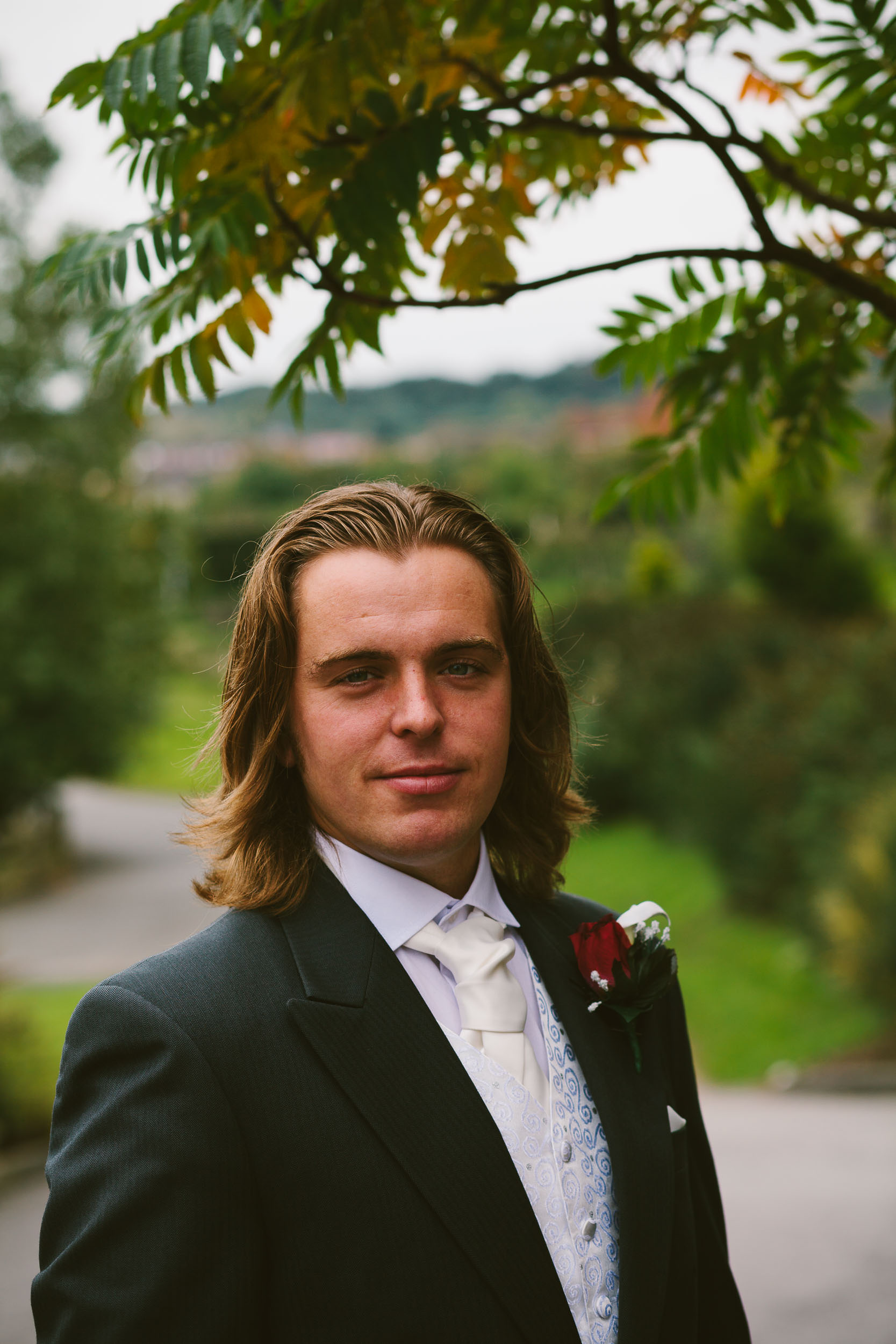 Portrait of the groom in grounds of South Causey Inn
