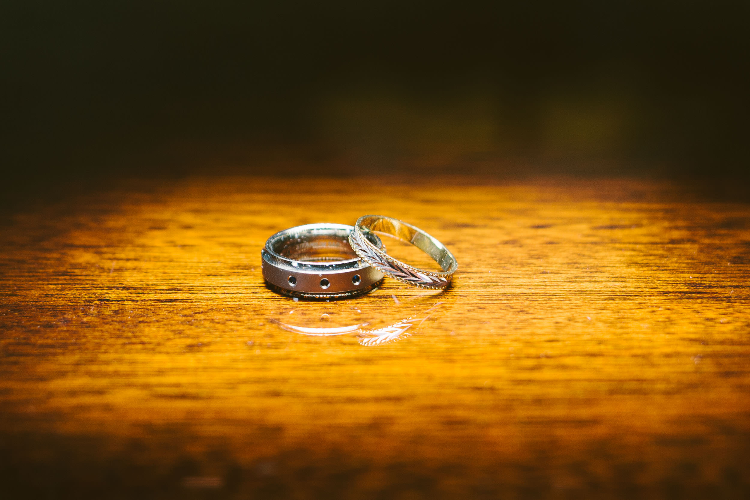 Wedding rings ling on a wooden table