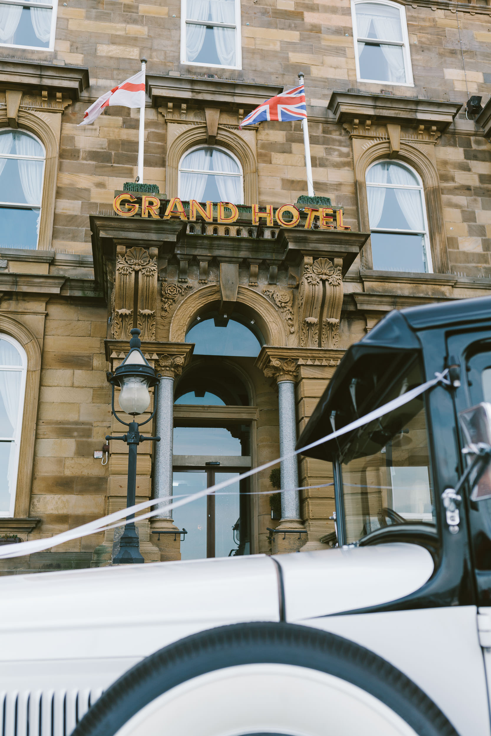 Bridal car arrives outside Grand Hotel wedding venue