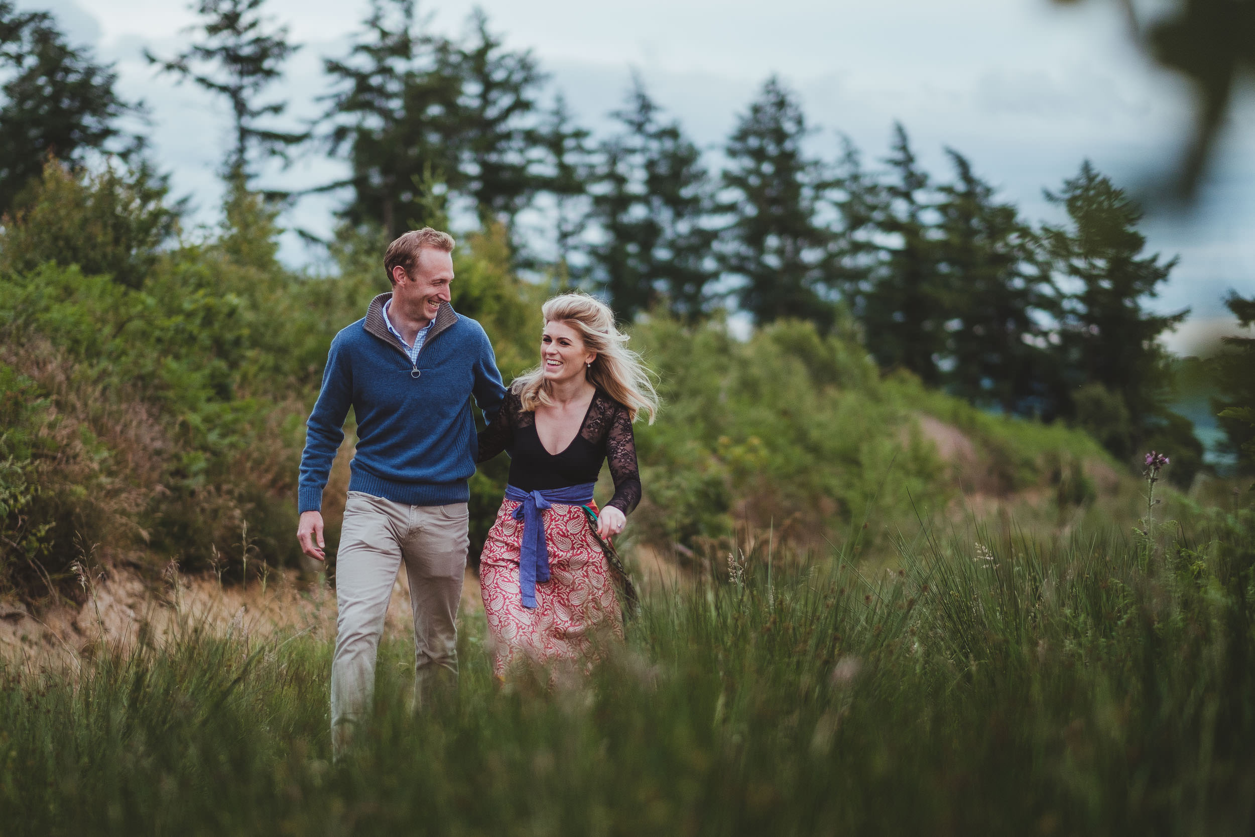 A couple laughing as they walk through a country path in Yorkshire