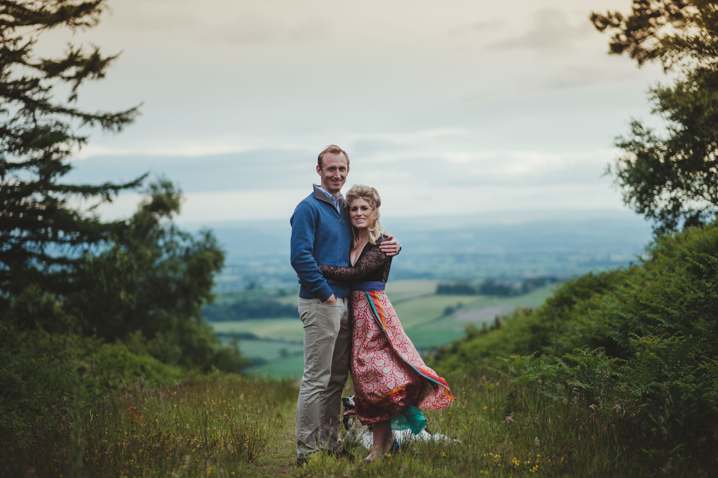 Couple cuddle on path high in Yorkshire hills