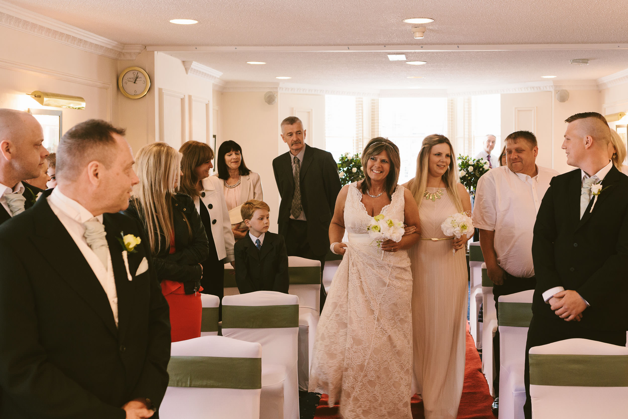 The bride walks down the aisle and makes eye contact with the groom