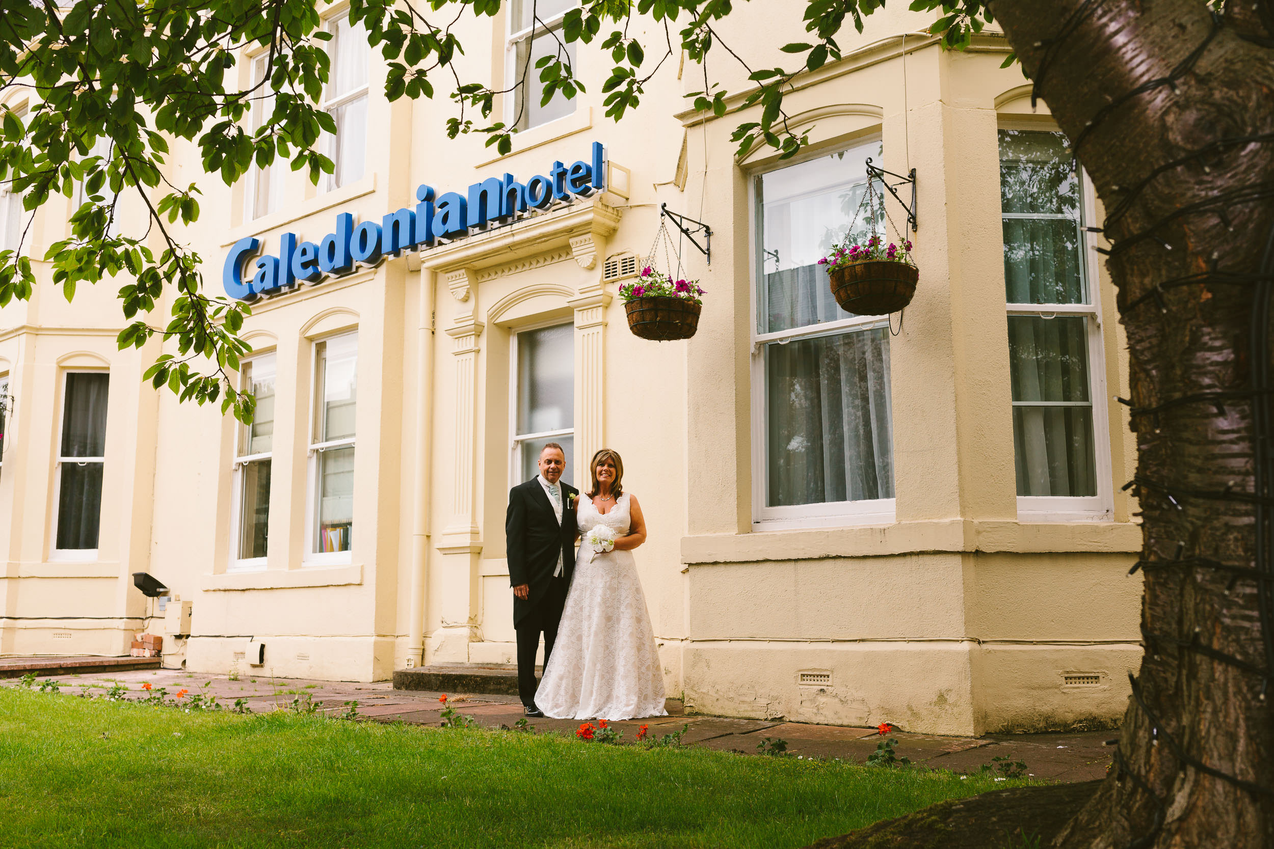 Newly married couple pose outside Caledonian Hotel in Newcastle