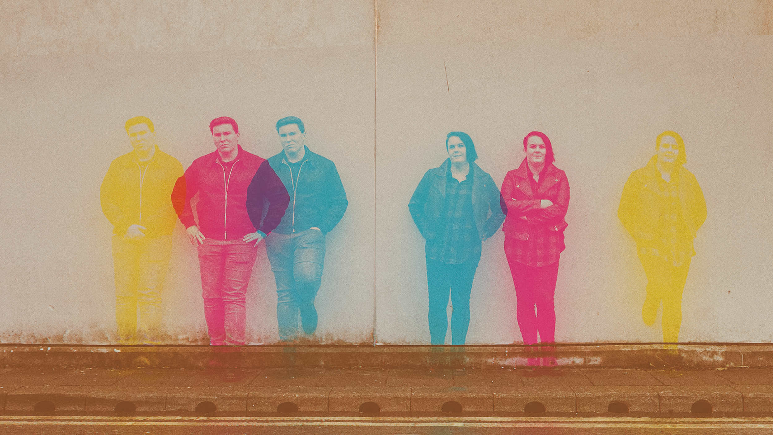 A colour spread triple exposure of a couple leaning against a wall on Newcastle Quayside
