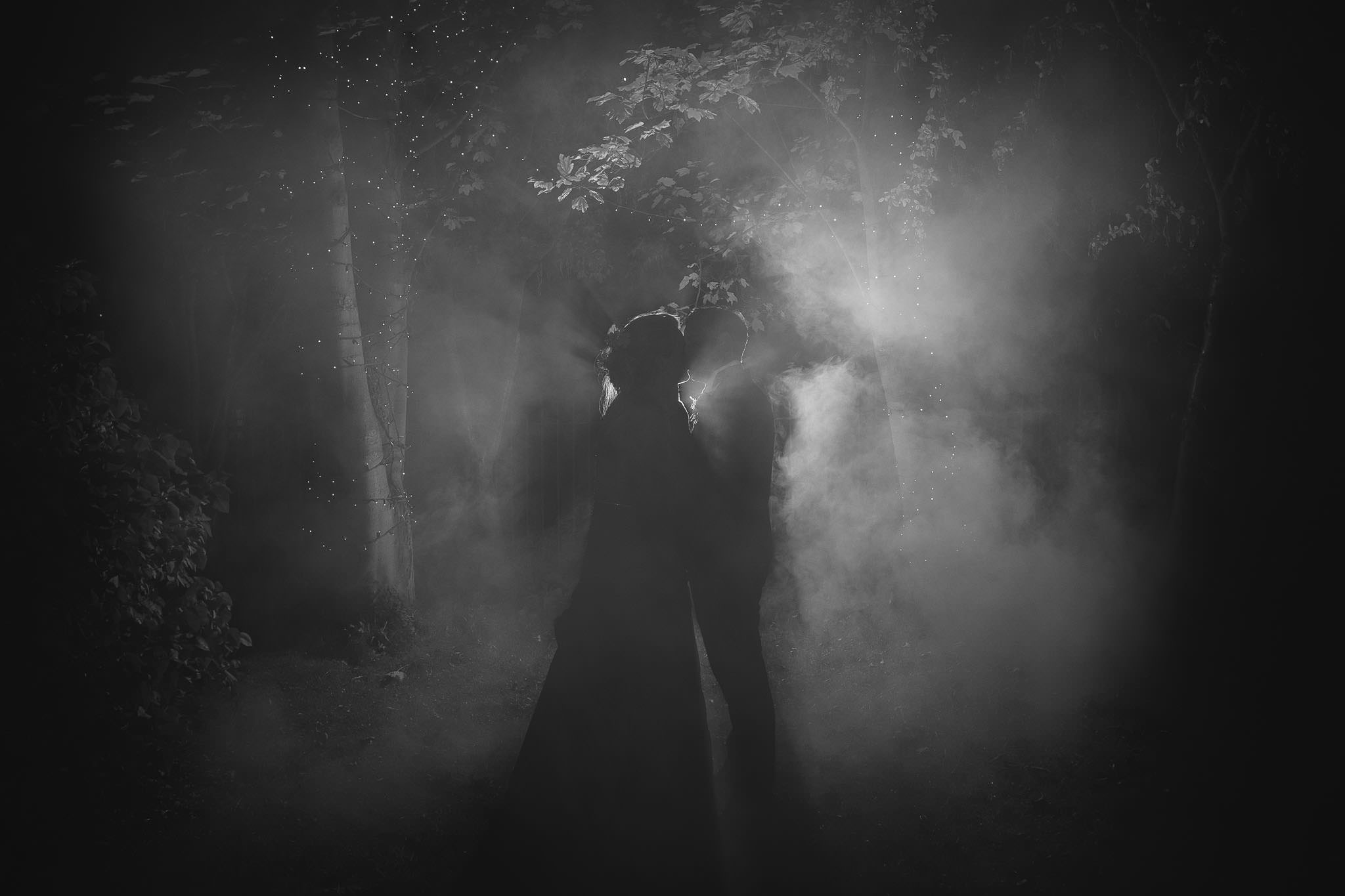 Off camera flash and smoke bombs make for creative wedding portraits