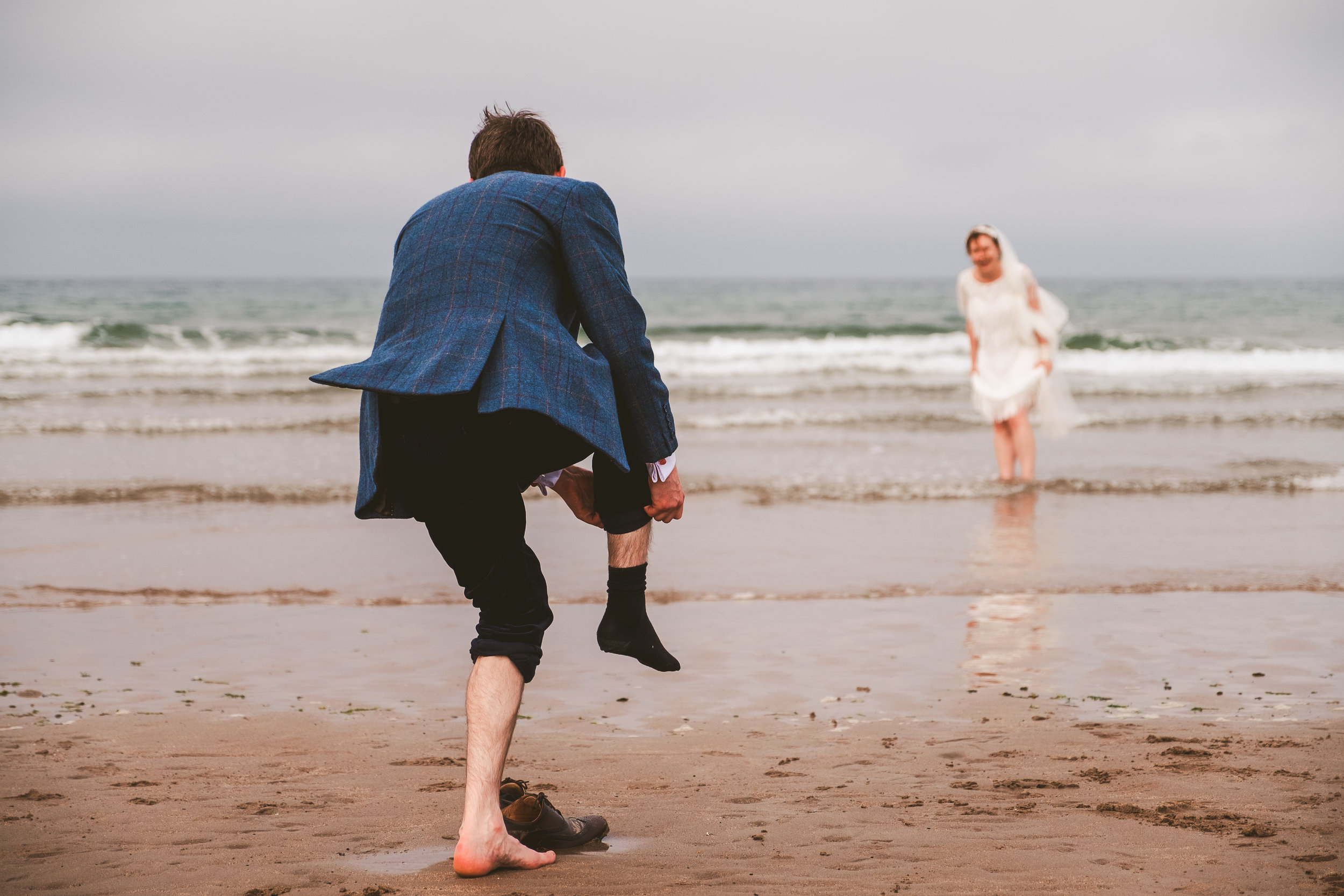 Ellie and James enjoying their wedding day on the Northumberland coast