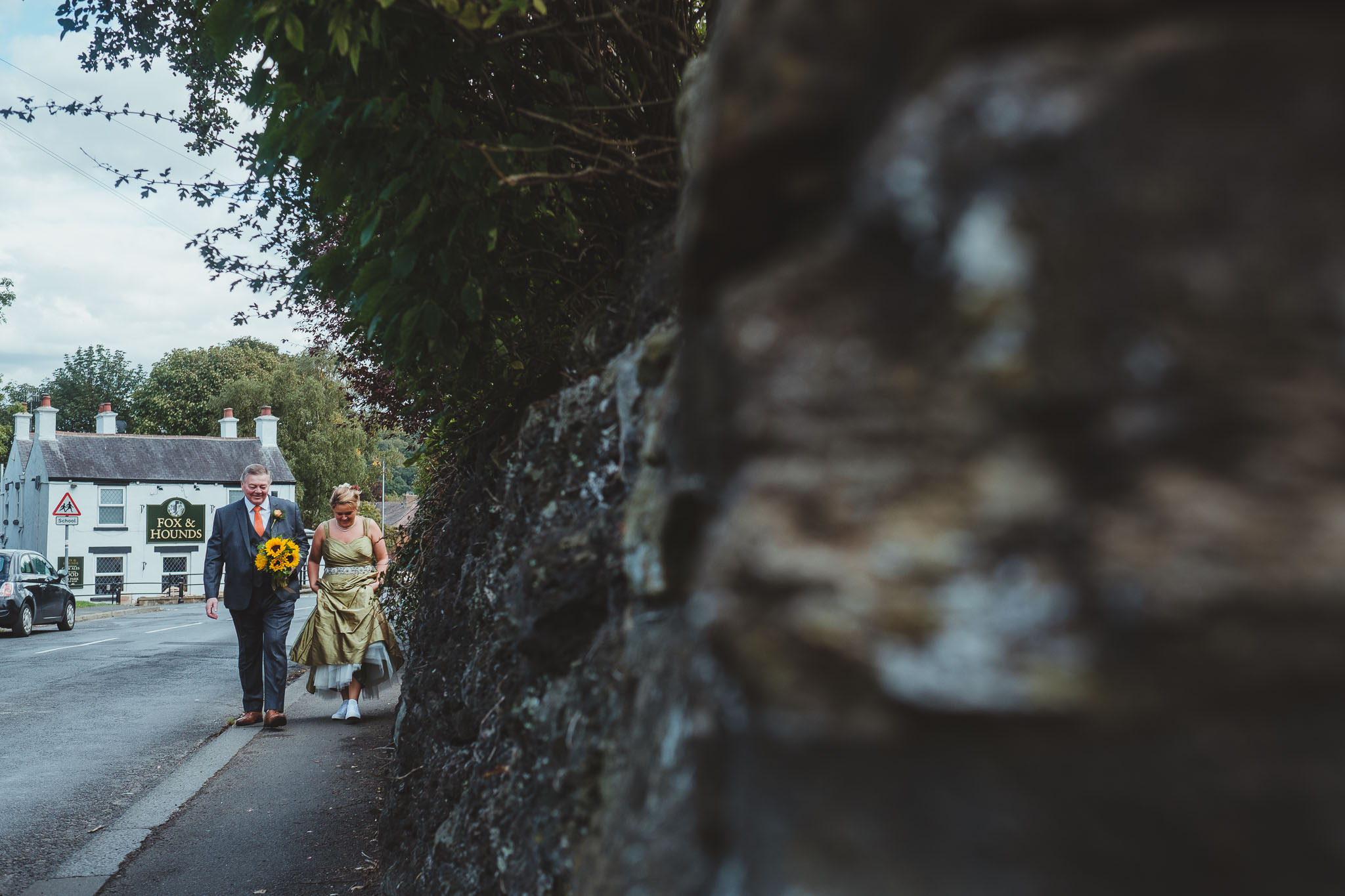 Bride and her father walk through Wylam to the church