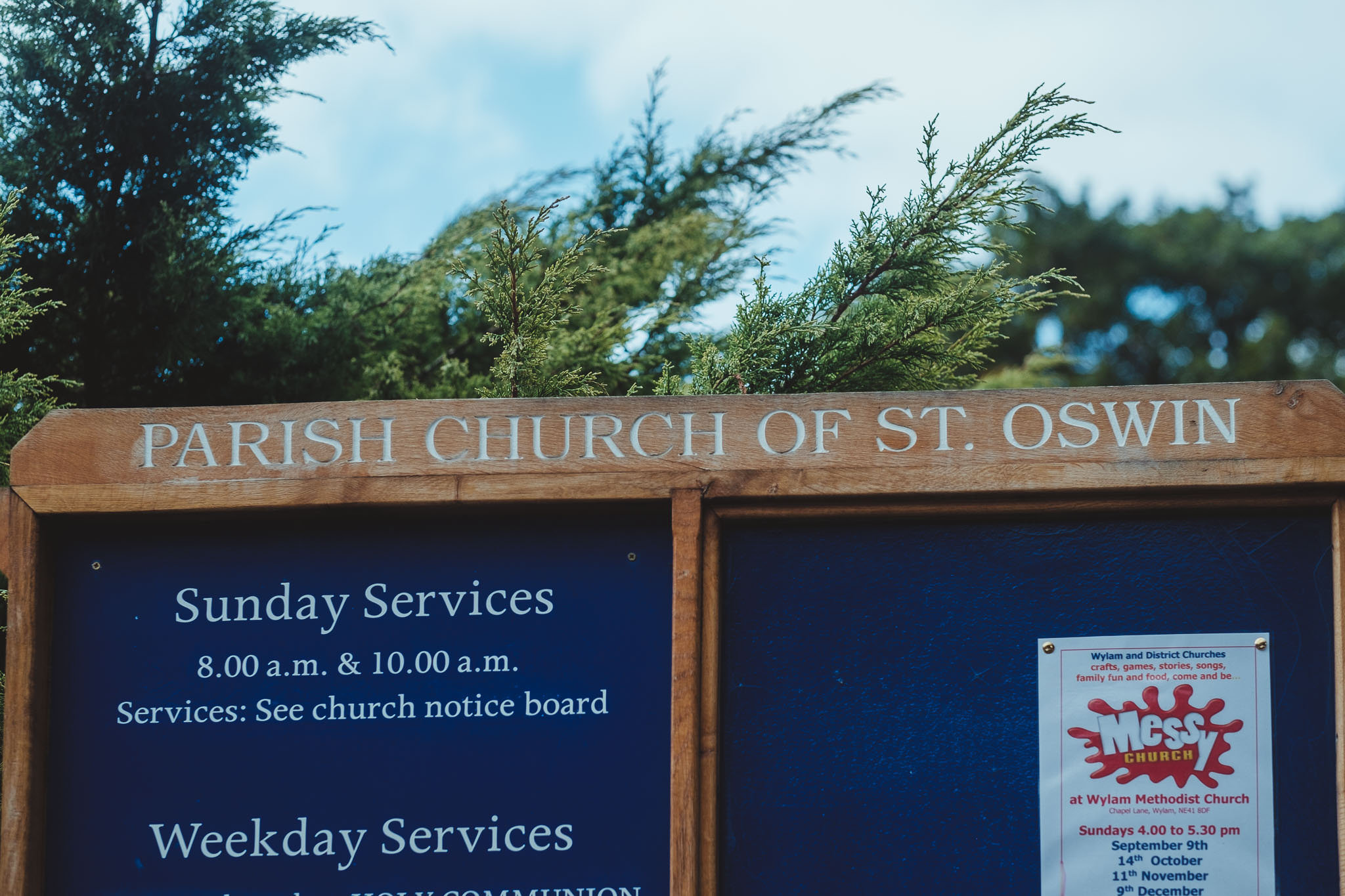 Close up of the sign for the church of St Oswin's near Newcastle