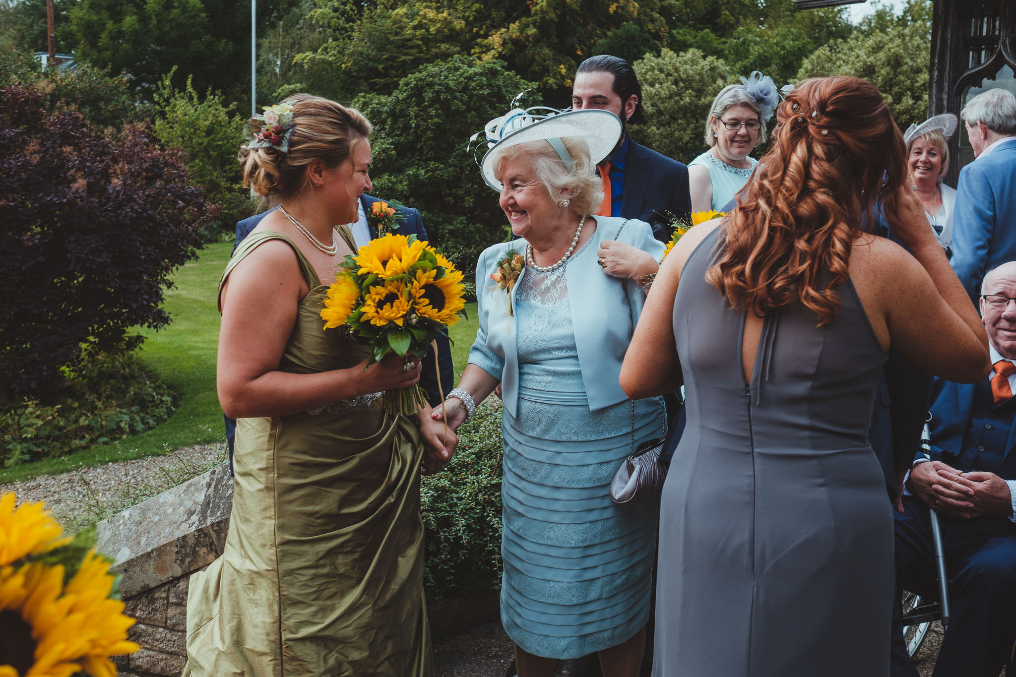 Bride greeted by mother of the groom after her wedding ceremony