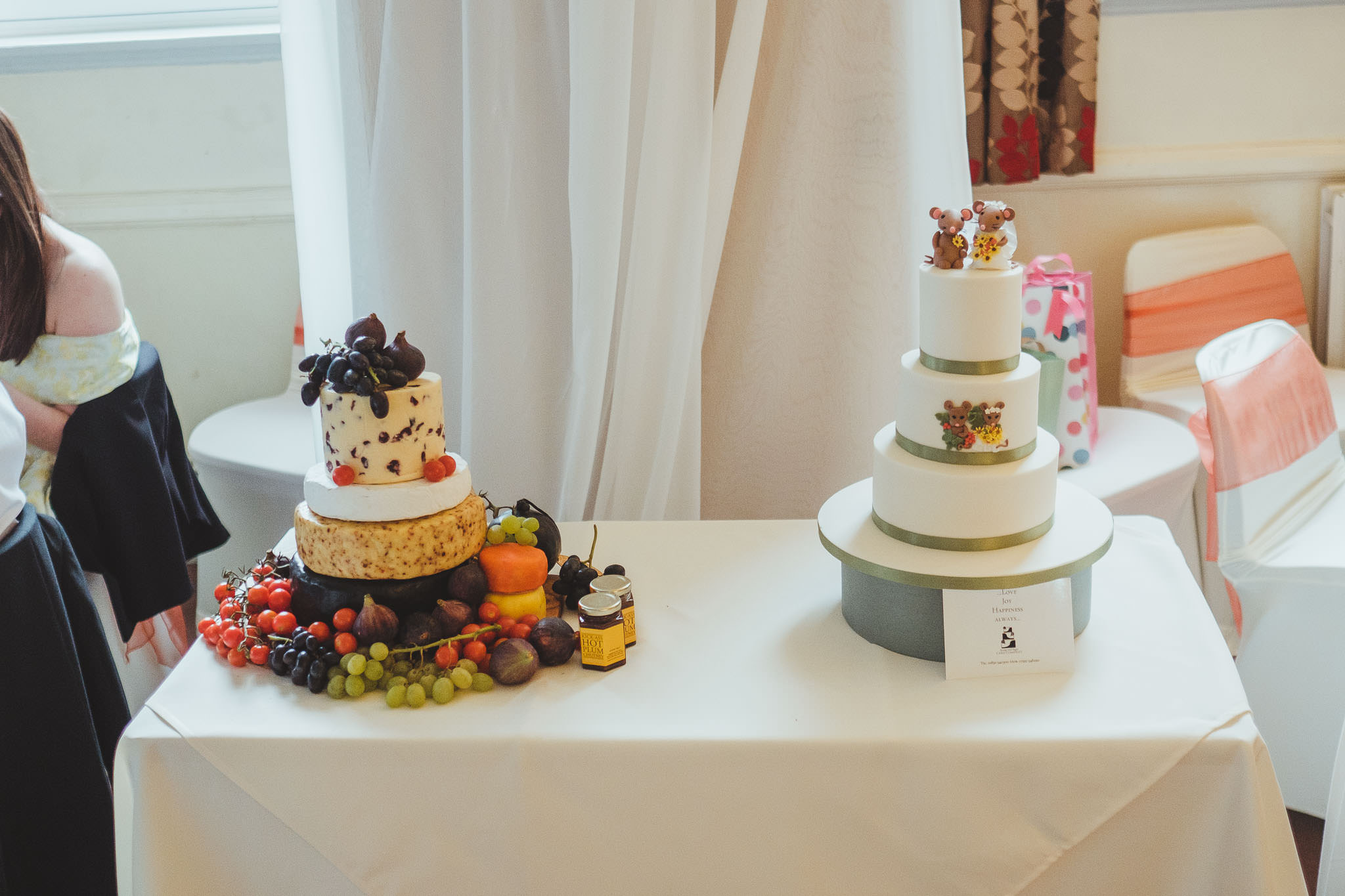 Wedding cake and cheese wheel
