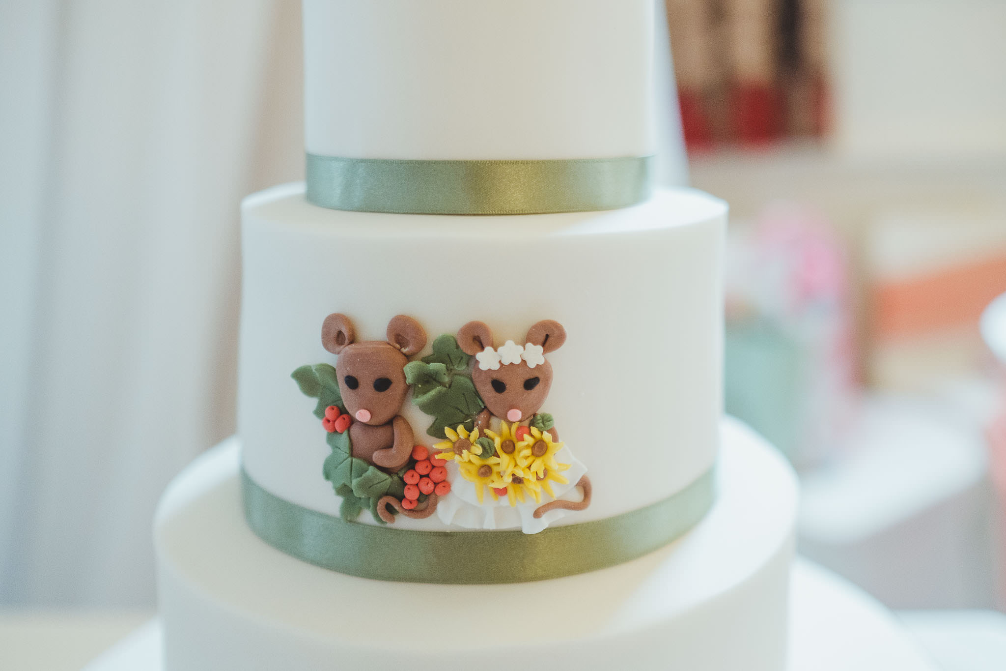 Wedding cake close up of field mice decorations