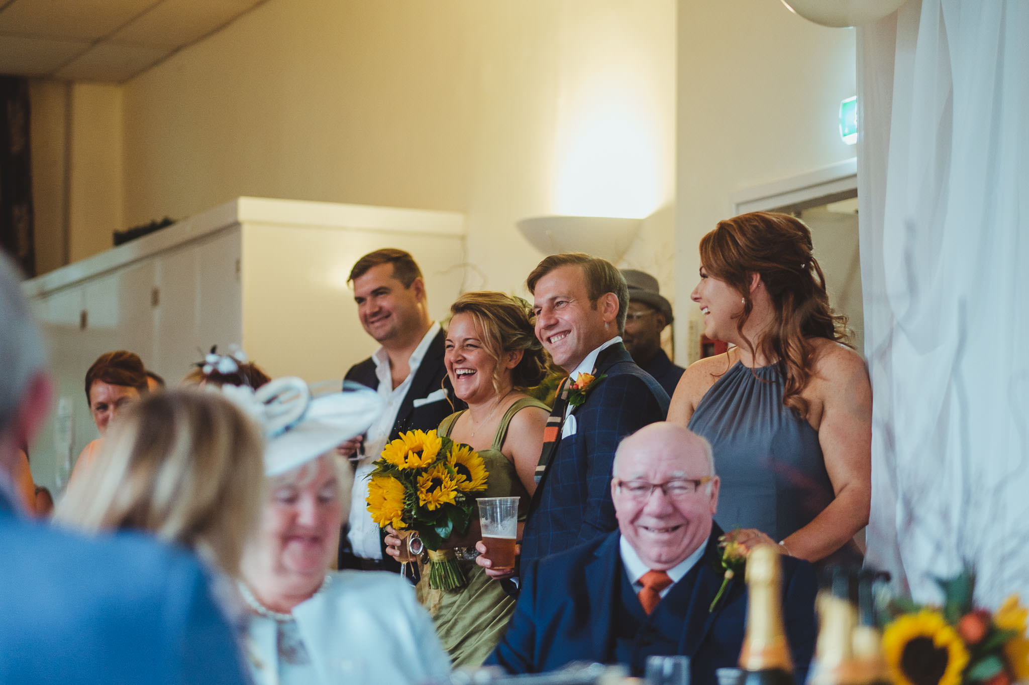 Bride and groom laugh at the best man's speech