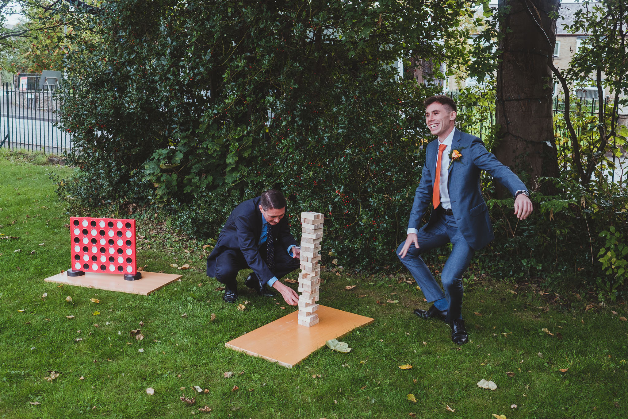 Wedding guests playing giant Jenga outside Wylam Institute