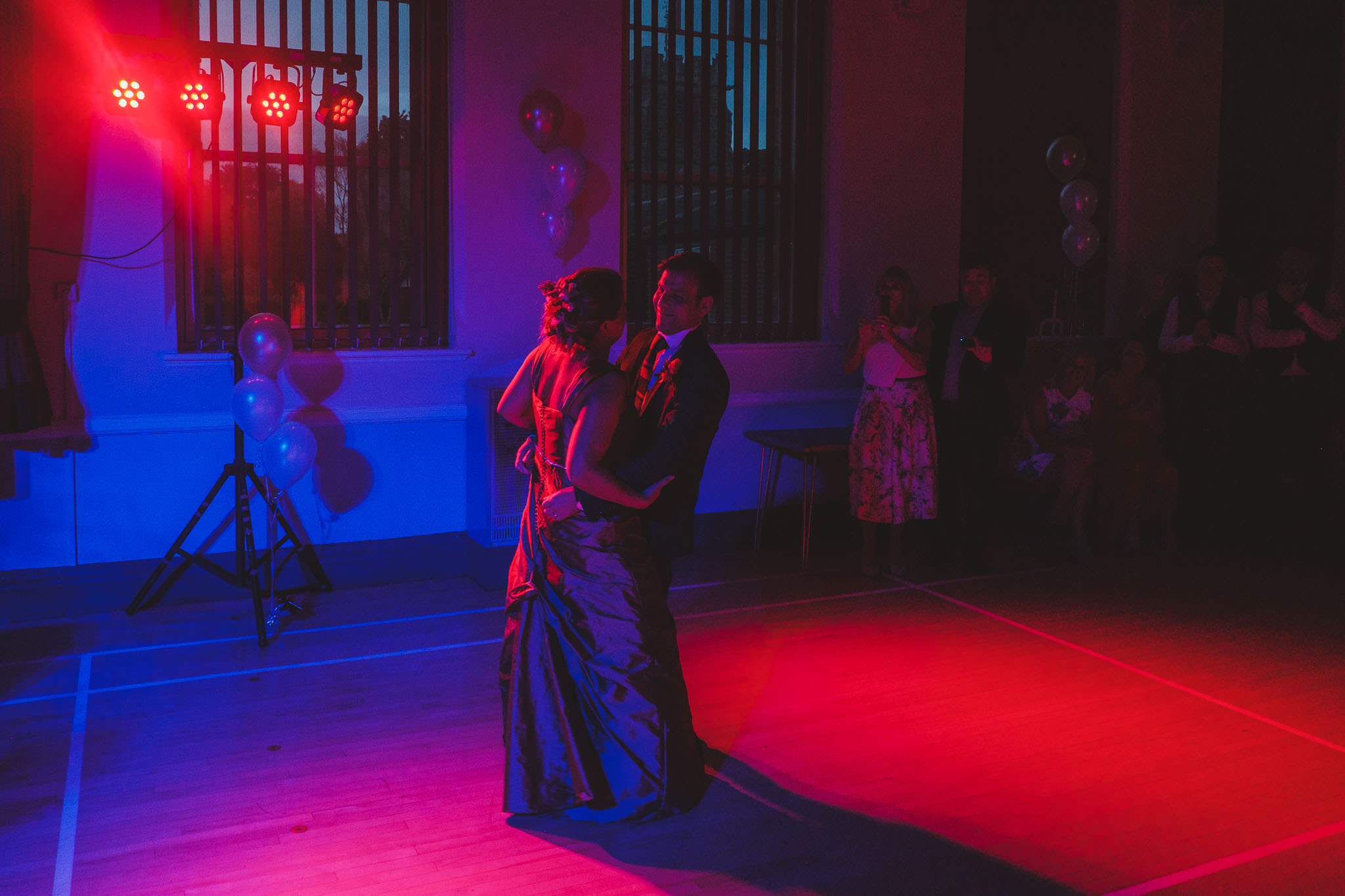 Bride and groom first dance in red and blue light