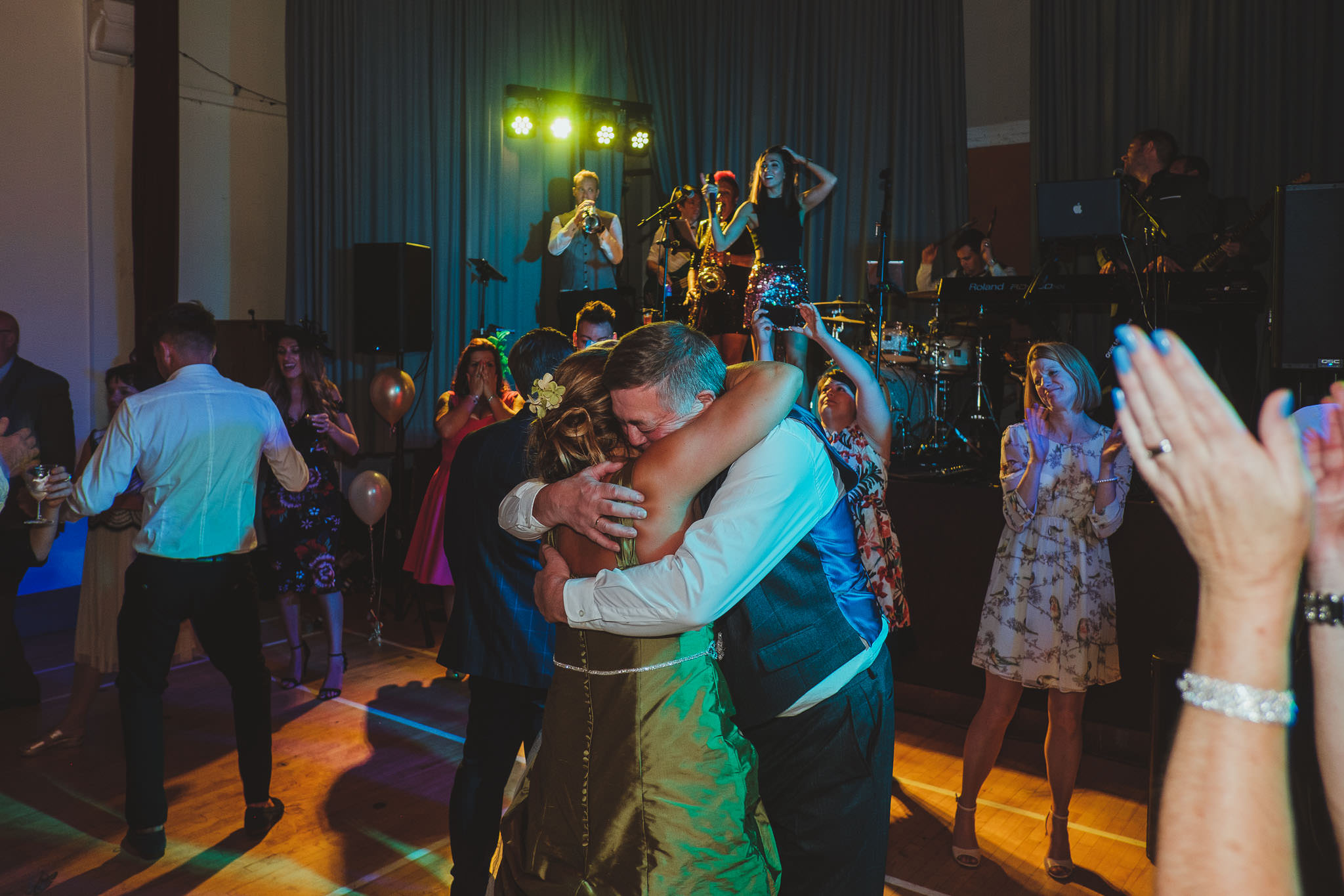 Bride and her father hug emotionally on the dance floor