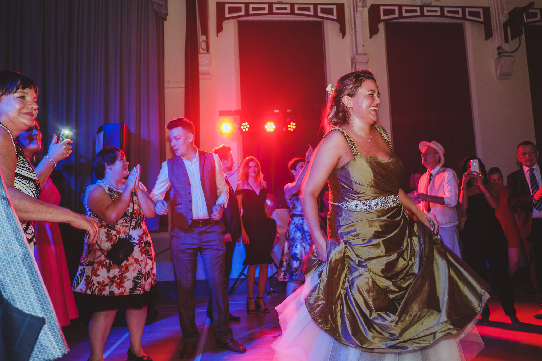 A colourful photo of the bride dancing