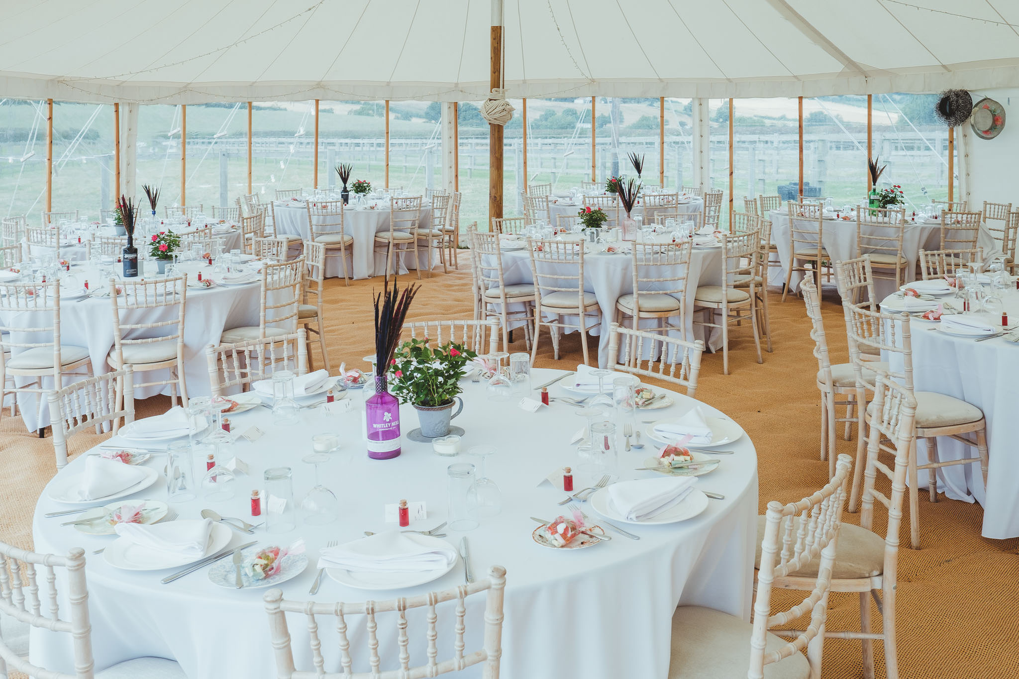 Tables set up in the wedding marquee