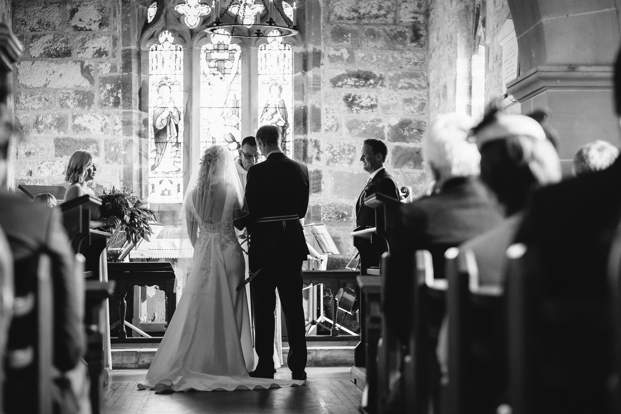 A black and white photo of the bride and groom during the wedding ceremony at Over Silton Yorkshire
