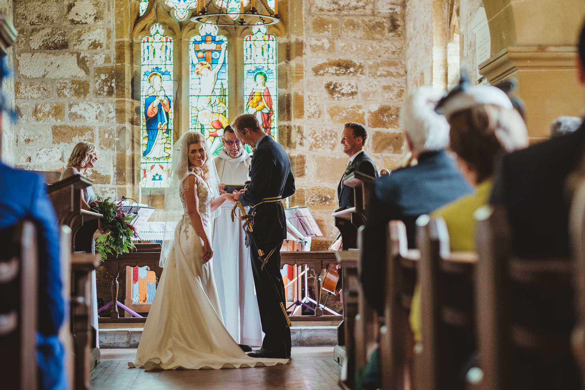 The bride and groom at the front of the church
