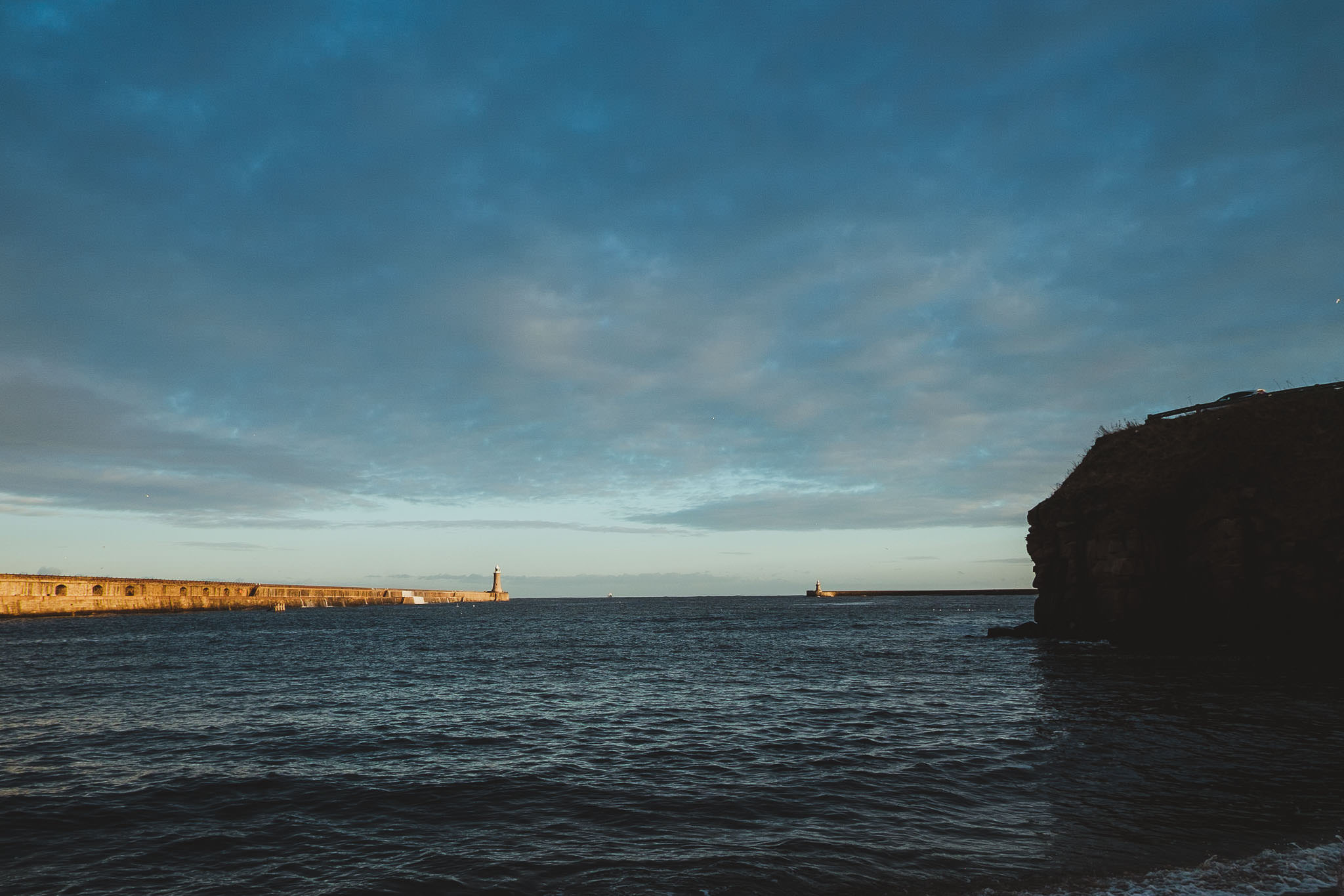 Lighthouse and harbour wall at Tynemouth