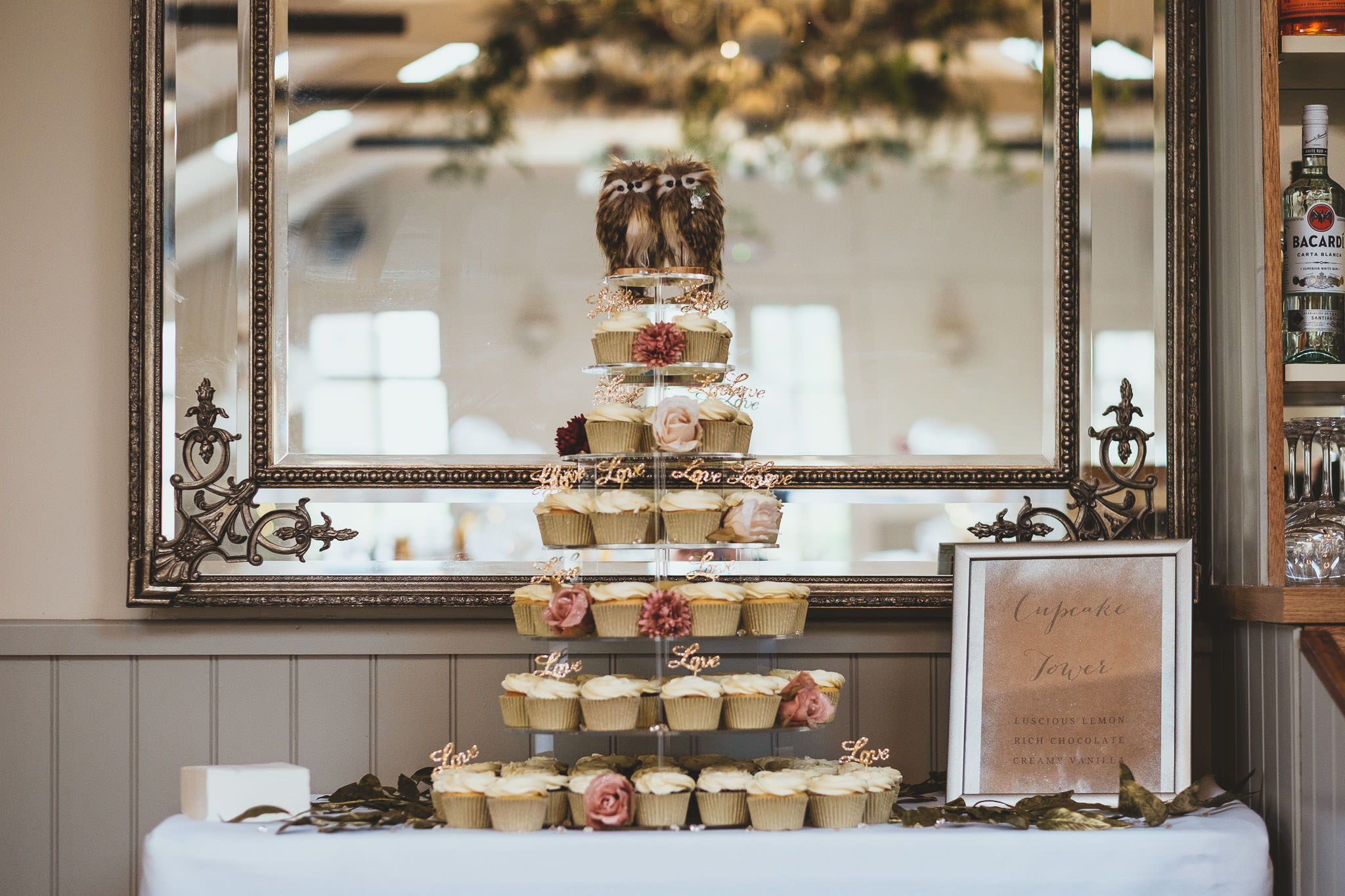 Cupcake wedding cake with owl toppers