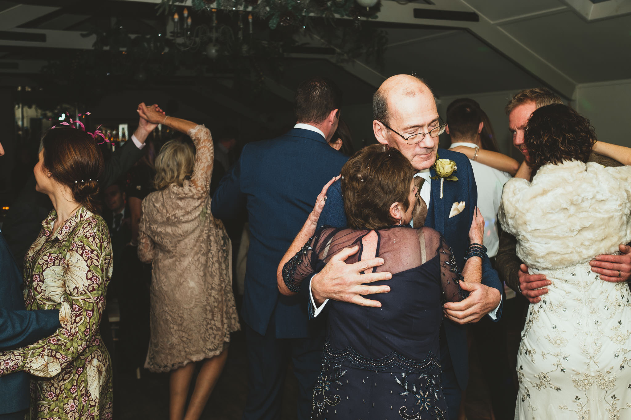 Bride's mother and father dance on wedding dance floor