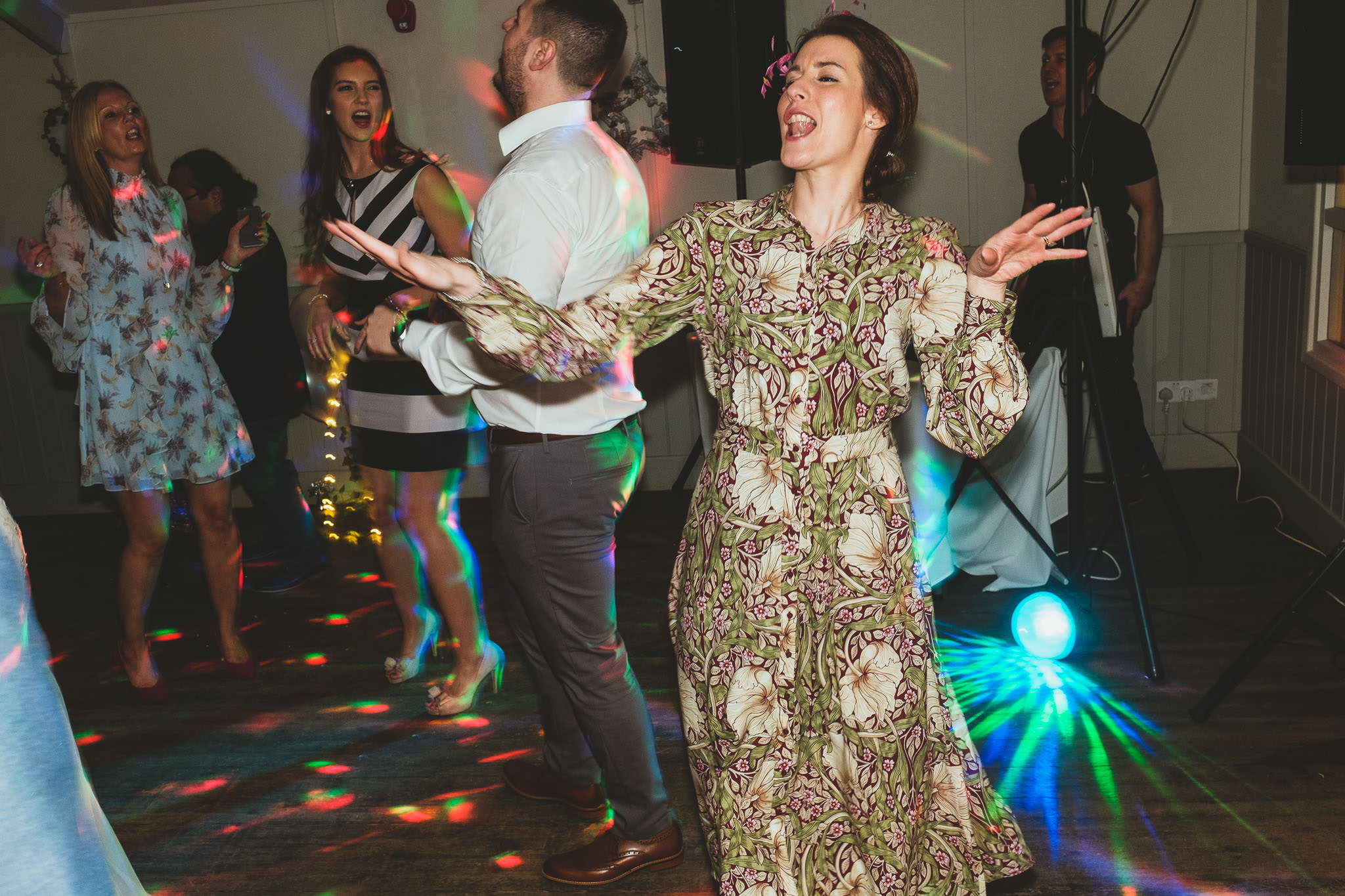 Guest dances energetically on wedding dance floor at The Parlour at Blagdon