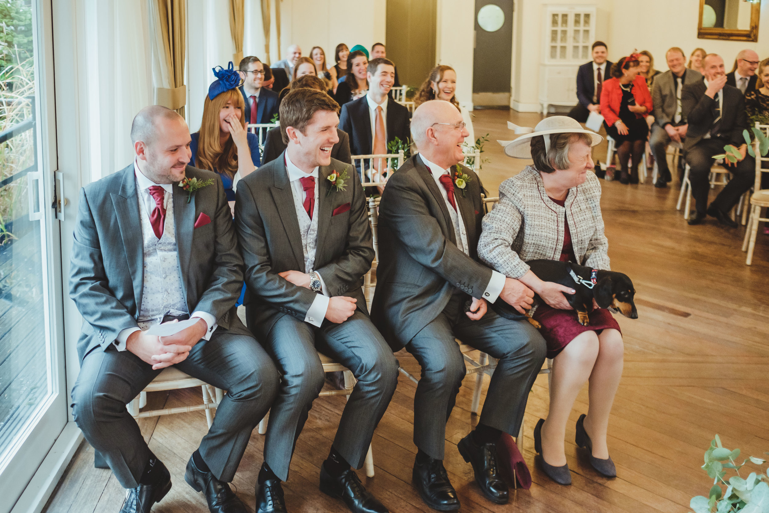 Wedding guests laugh as dog barks during the wedding ceremony