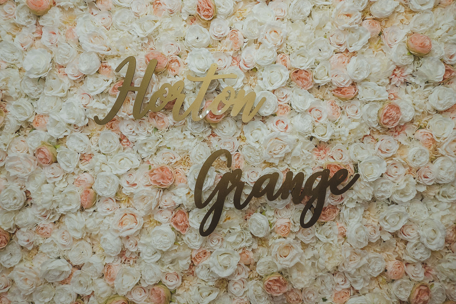 Horton Grange sign on flower wall