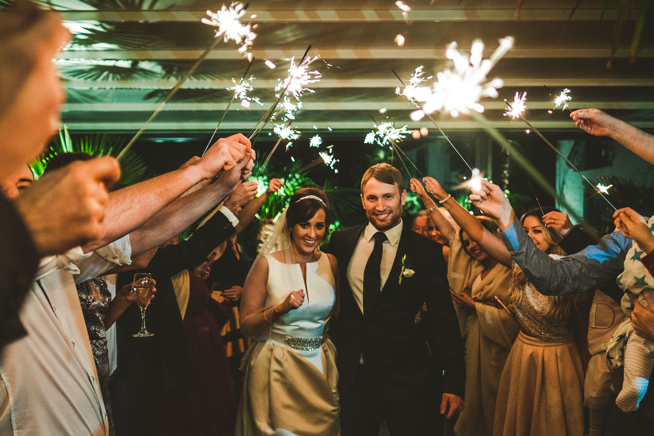 A sparkler exit at Alex & Sam's New Years Eve wedding at Le Petit Chateau just outside Newcastle