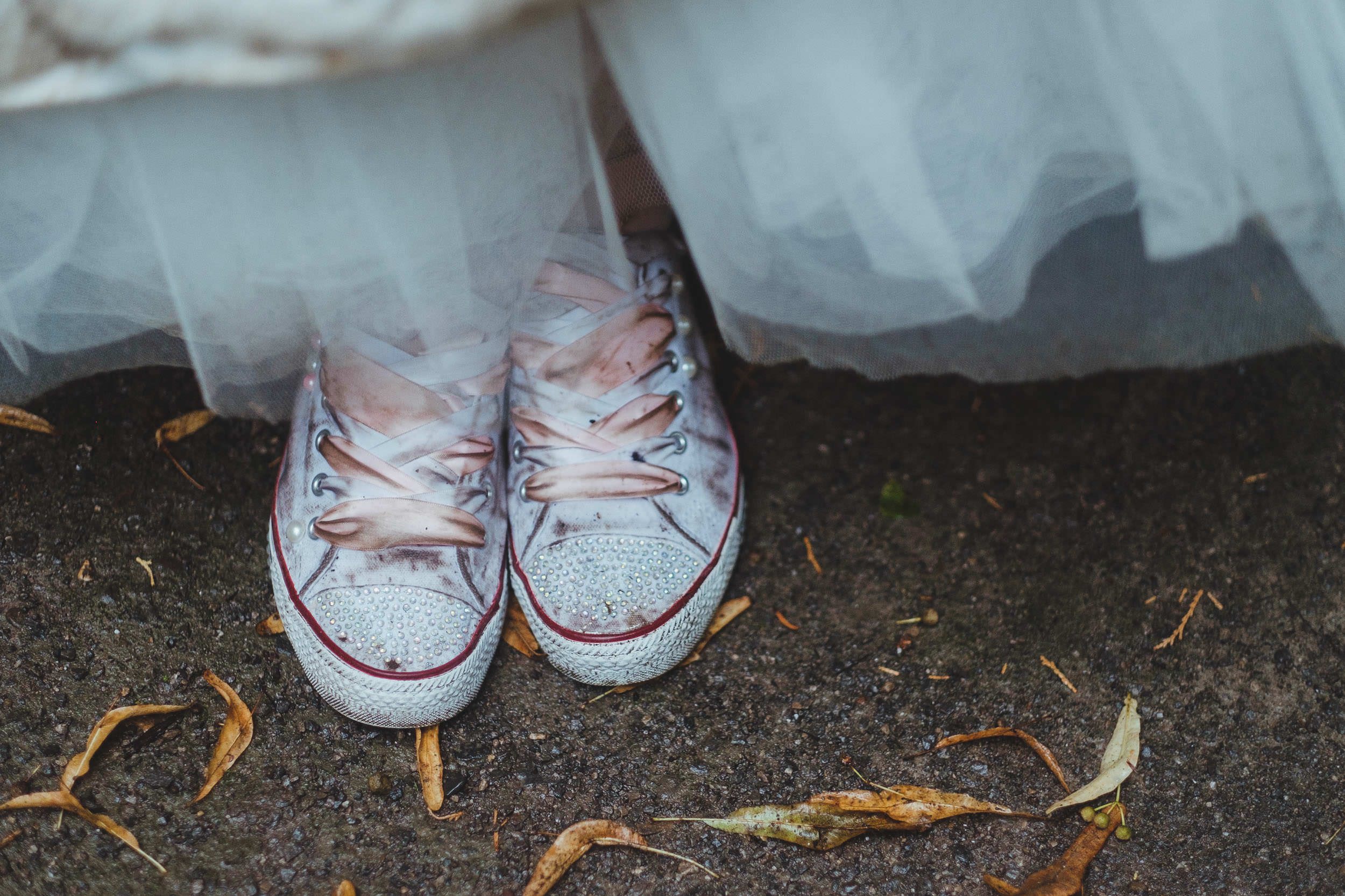 Muddy wedding shoes on a wet wedding day at Whitworth Hall