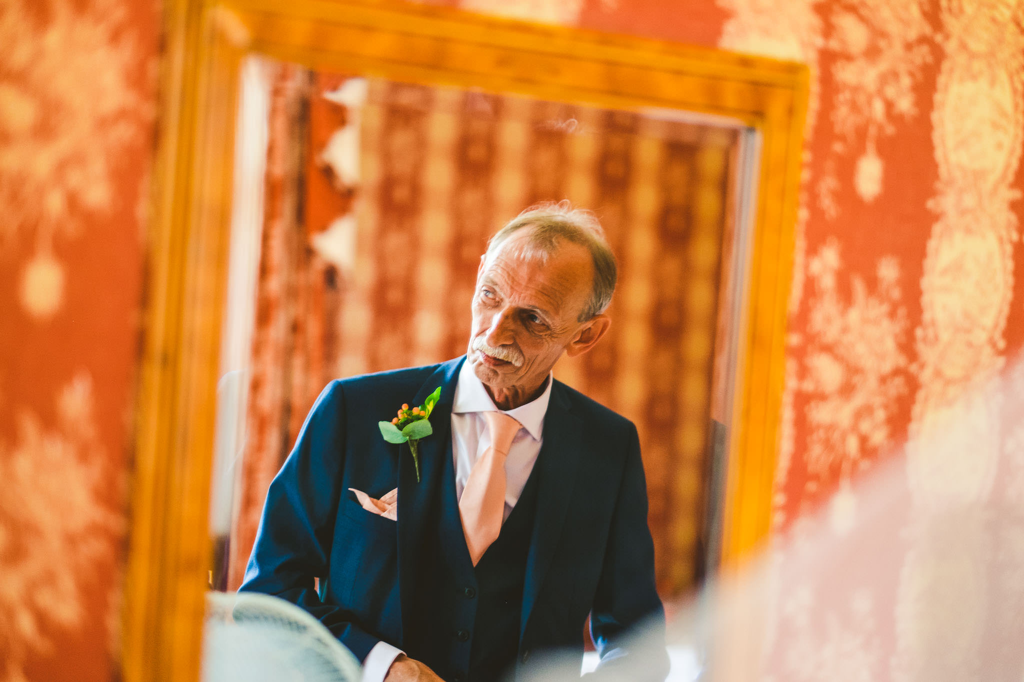 The father of the bride watching shares an emotional moment with his daughter