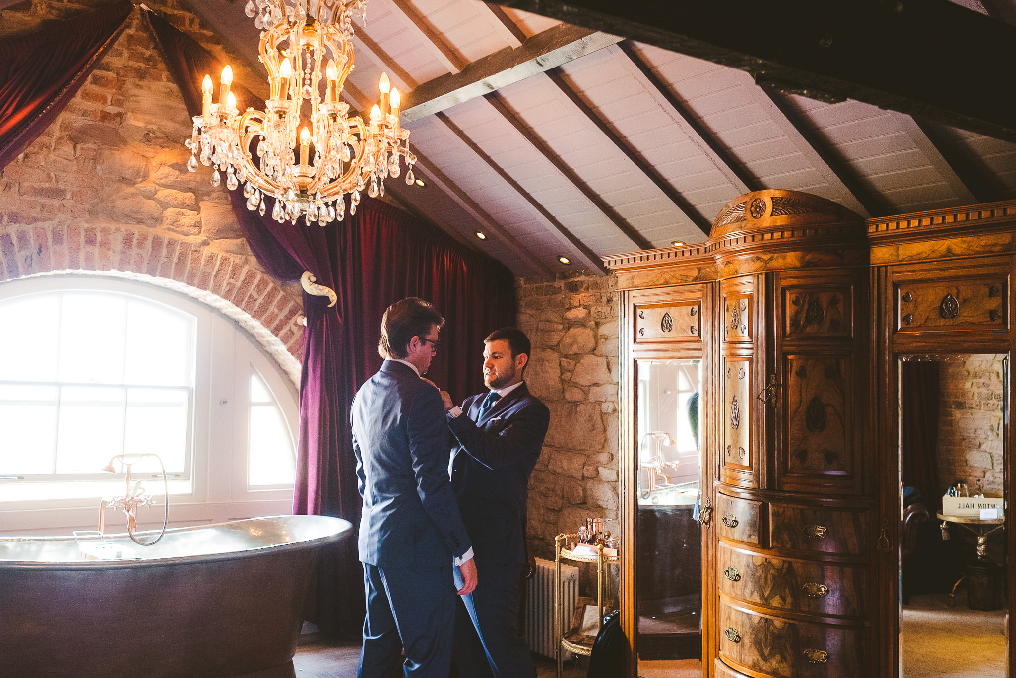 Best man helping the groom get ready at Newton Hall