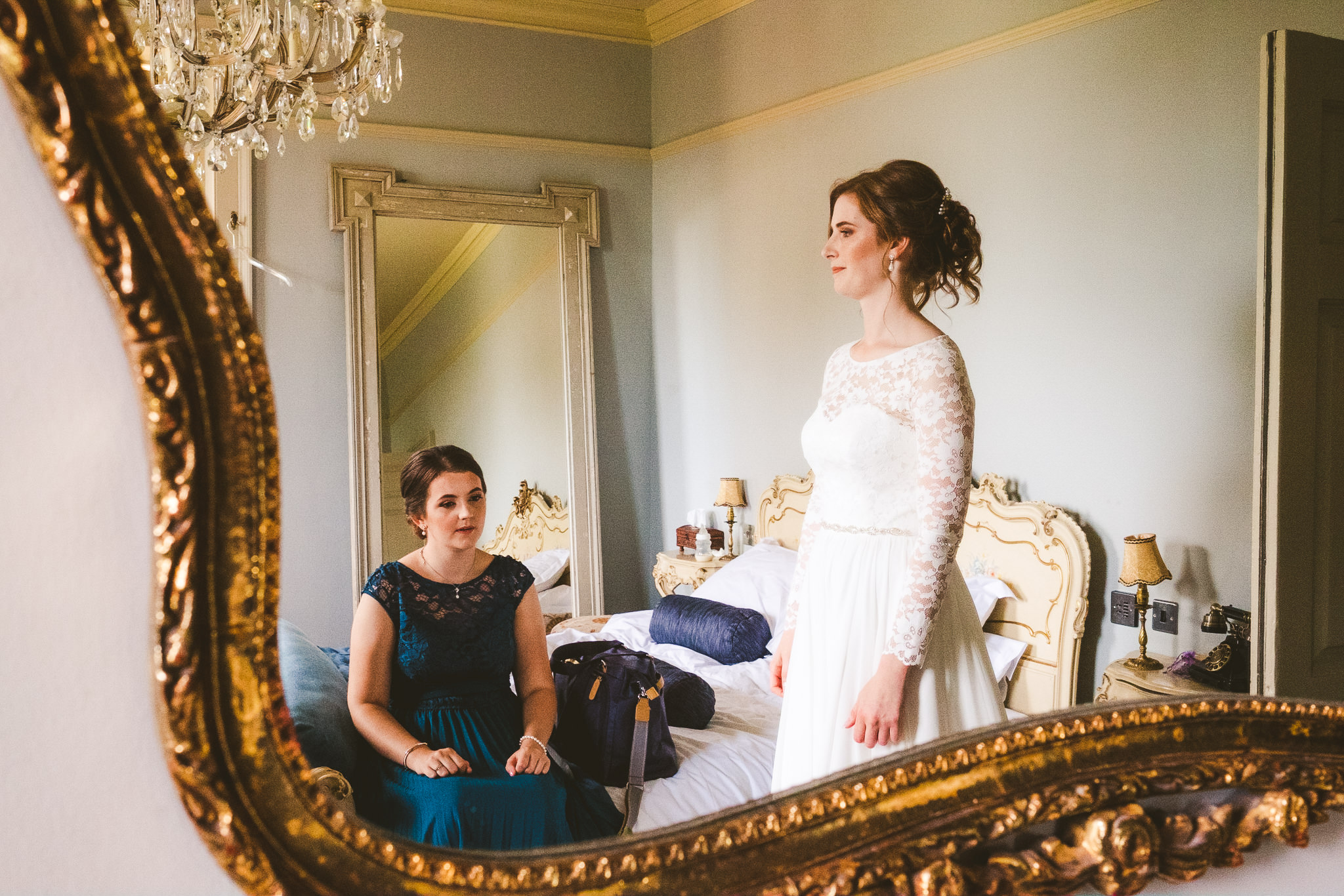 Bride and bridesmaid reflected in mirror