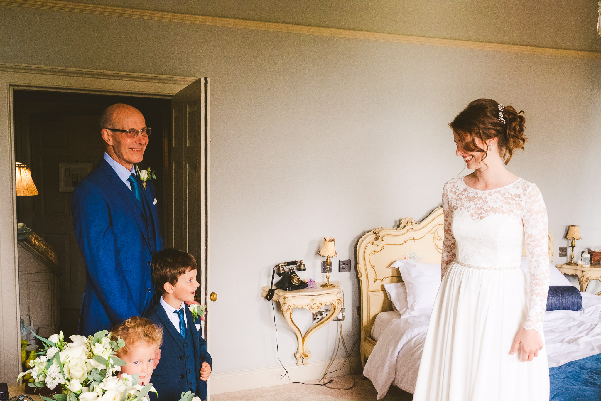 Father of the bride sees her for the first time before the wedding