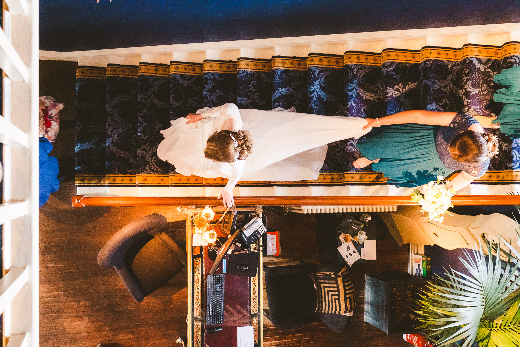 Overhead view of the bride walking down the stairs at Newton Hall