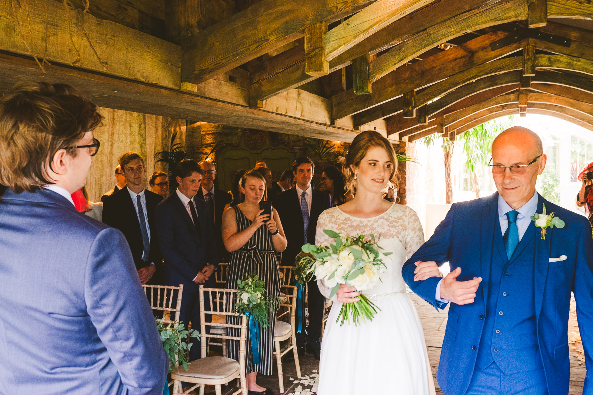 Bides, her father and the groom meet at the end of the aisle at Newton Hall