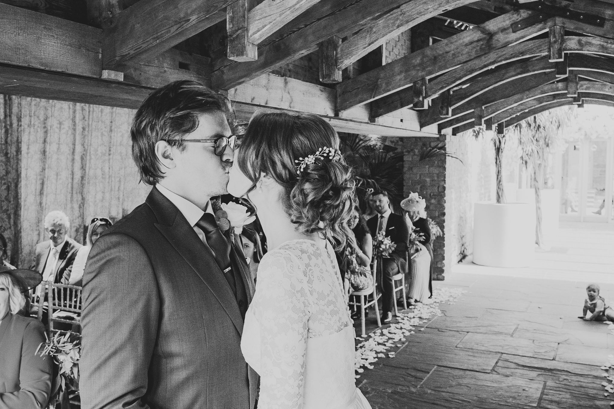 A black and white photo of the first kiss at Newton Hall